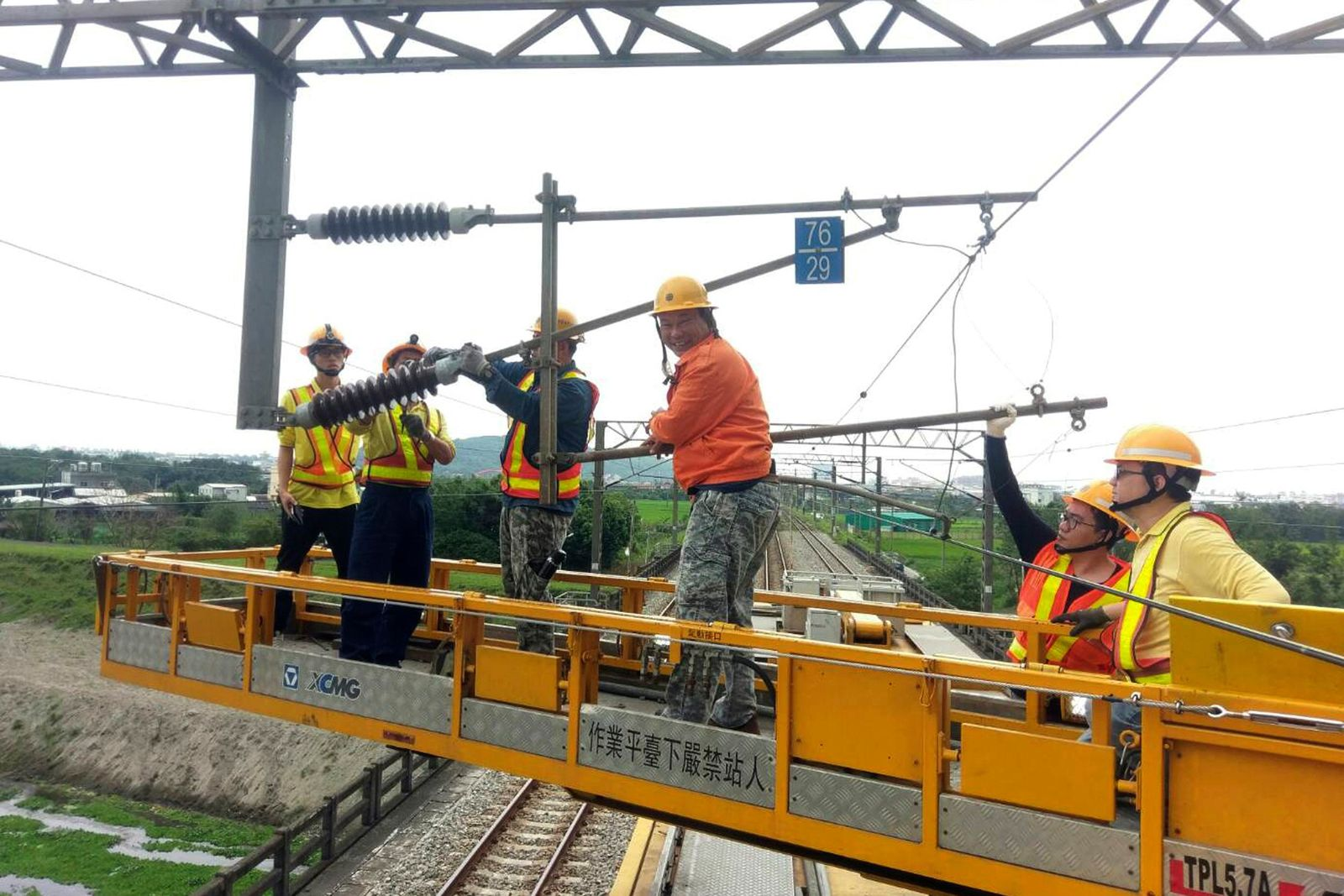 In this photo released by Taiwan Railways Administrations, workers repair damaged facilities for the railway line near Hualien in eastern Taiwan Thursday, April 18, 2019.(Taiwan Railways Administrations via AP)