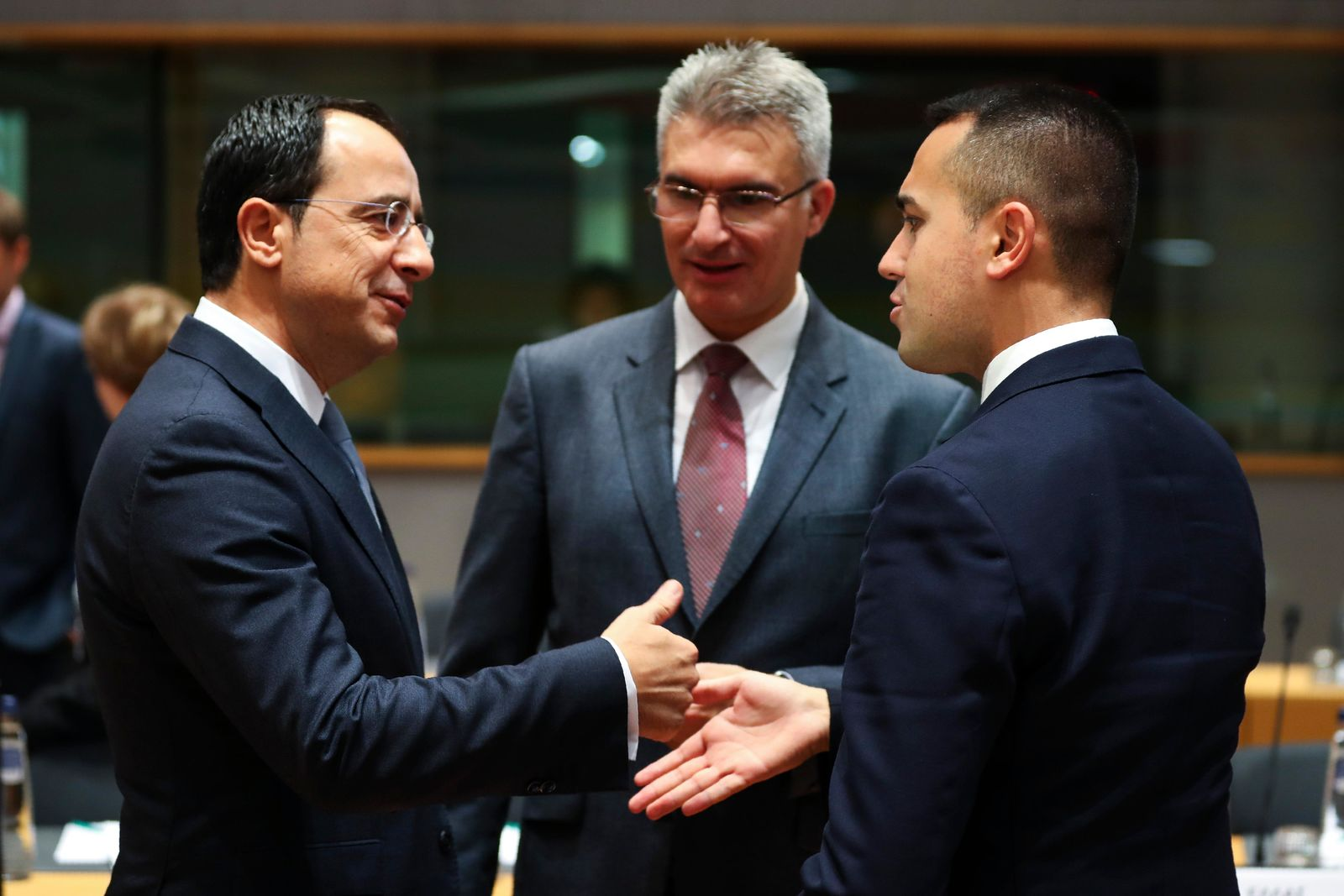 Italian Foreign Minister Luigi Di Maio, right, talks to Cyprus' Foreign Minister Nicos Christodoulides, left, and Malta's Foreign Minister Carmelo Abela during an European Foreign Affairs Ministers meeting at the Europa building in Brussels, Monday, Nov. 11, 201 (AP Photo/Francisco Seco)