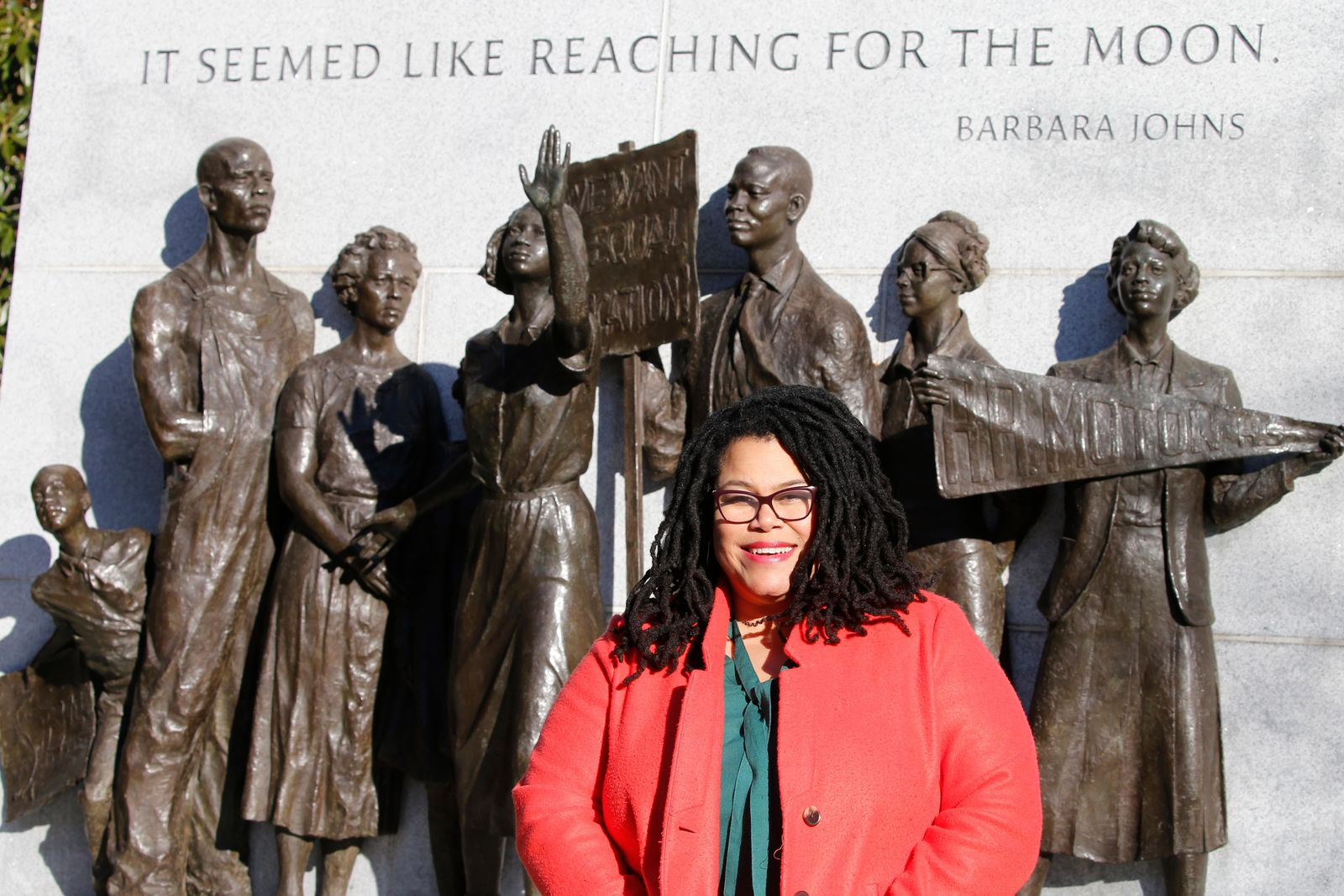 Wake Forest alumni Palinda Carrington poses in front of the Virginia Civil Rights Monument on Capitol Square in Richmond, Va., Sunday, Dec. 15, 2019. (AP Photo/Steve Helber)