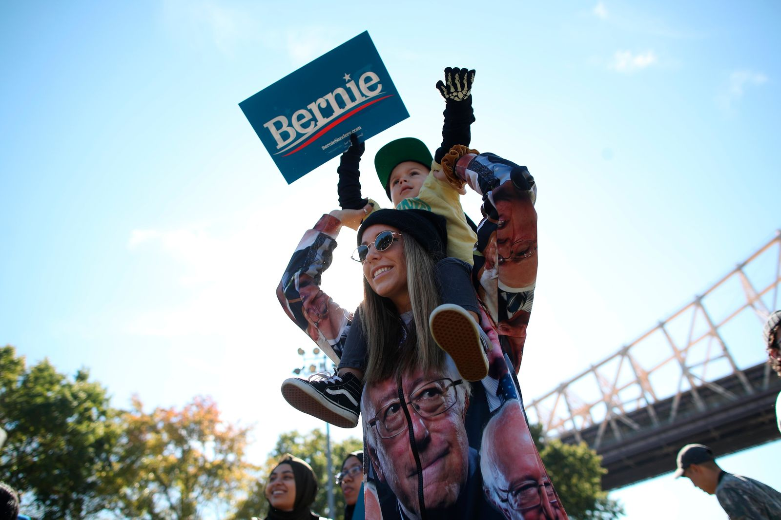 Keight Bowe holds her son her son Maddox, 3, during a campaign rally for Democratic presidential candidate Sen. Bernie Sanders, I-Vt., on Saturday, Oct. 19, 2019 in New York. (AP Photo/Mary Altaffer)