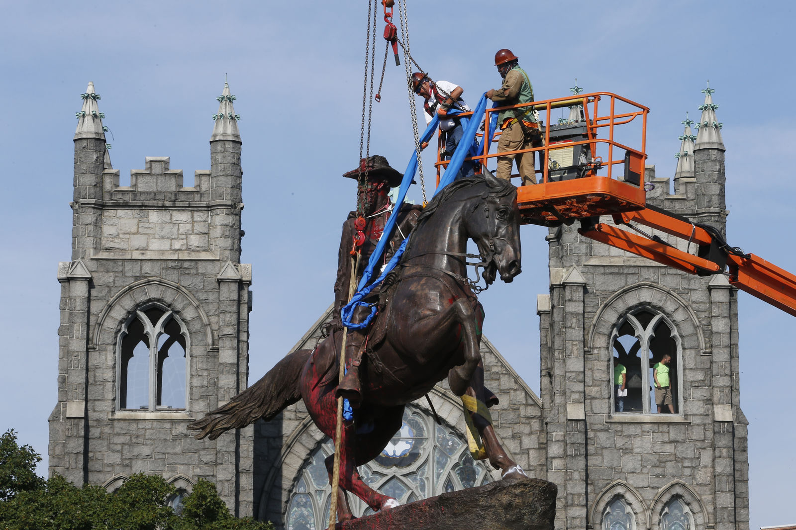FILE – Crews attach straps to the statue Confederate General J.E.B. Stuart on Monument Avenue Tuesday July 7, 2020, in Richmond, Va. (AP Photo/Steve Helber)
