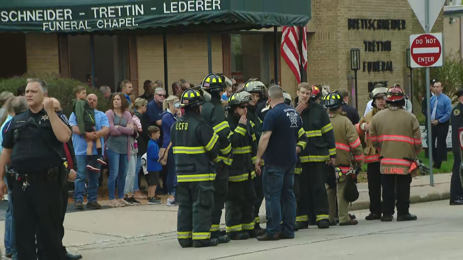 Firefighters and community members pay respects to the body of a fallen Appleton firefighter at the Brettschneider-Trettin-Nickel Funeral Chapel in Appleton, May 16, 2019. (WLUK)