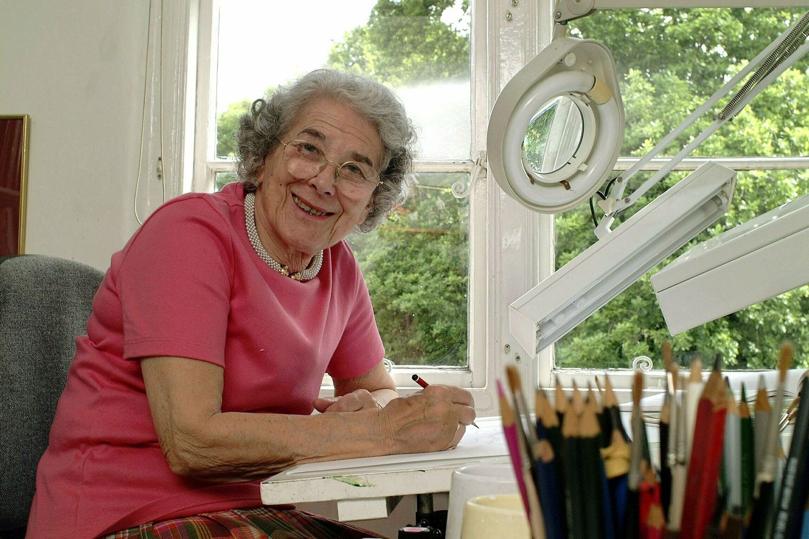 "FILE - In this May 23, 2003 file photo British writer Judith Kerr sits in her working room in London, England. Judith Kerr, author and illustrator of the bestselling ""The Tiger Who Came to Tea"" and other beloved children's books, has died at the age of 95. ( Daniel Sambraus/dpa via AP)"