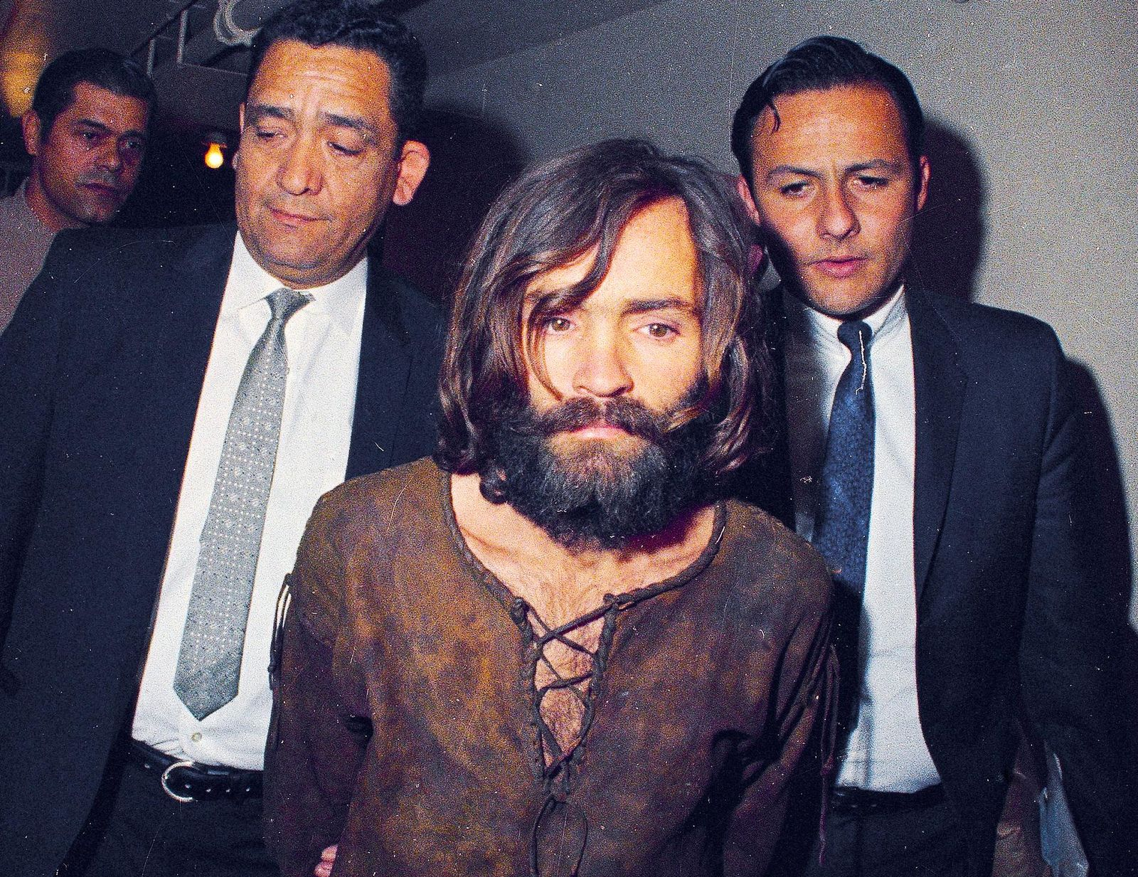 FILE - In this 1969 file photo, Charles Manson is escorted to his arraignment on conspiracy-murder charges in connection with the Sharon Tate murder case in Los Angeles. (AP Photo/File)
