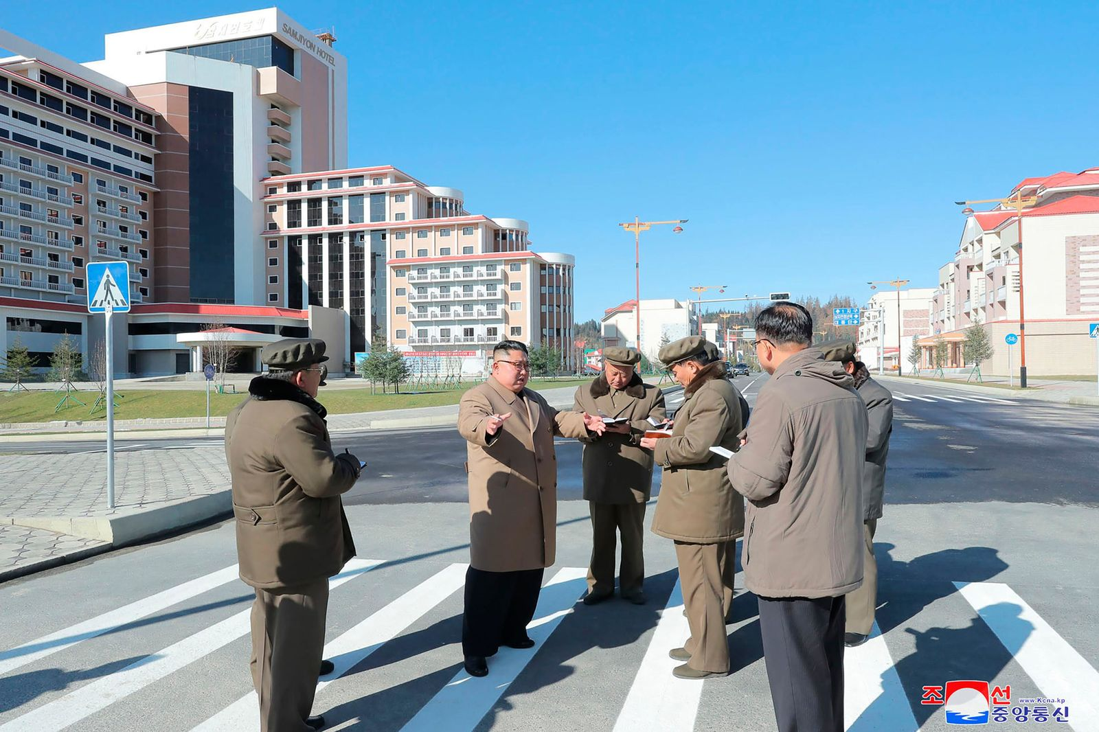 "In this undated photo provided on Wednesday, Oct. 16, 2019, by the North Korean government, North Korean leader Kim Jong Un, second left, visits a construction site in Samjiyon County, North Korea. Independent journalists were not given access to cover the event depicted in this image distributed by the North Korean government. The content of this image is as provided and cannot be independently verified. Korean language watermark on image as provided by source reads: ""KCNA"" which is the abbreviation for Korean Central News Agency. (Korean Central News Agency/Korea News Service via AP)"