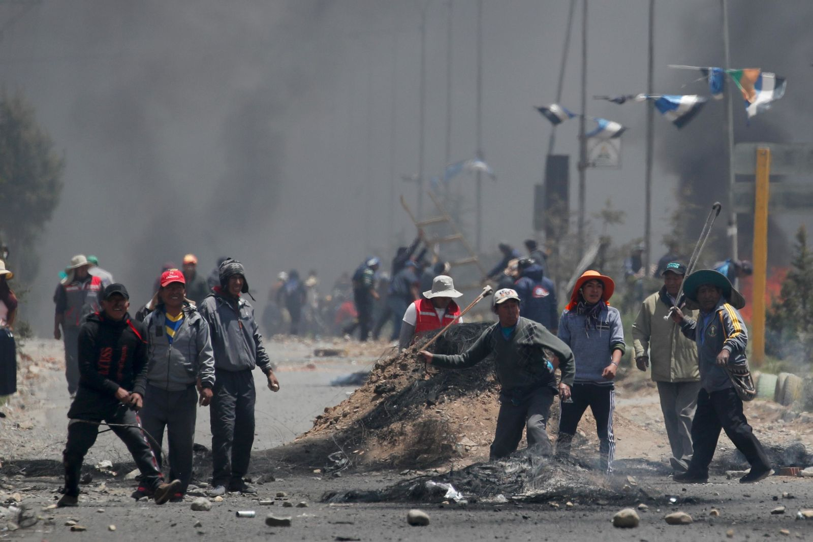Supporters of former President Evo Morales clash with security forces in El Alto, on the outskirts of La Paz, Bolivia, Tuesday, Nov. 19, 2019.{ } (AP Photo/Natacha Pisarenko)