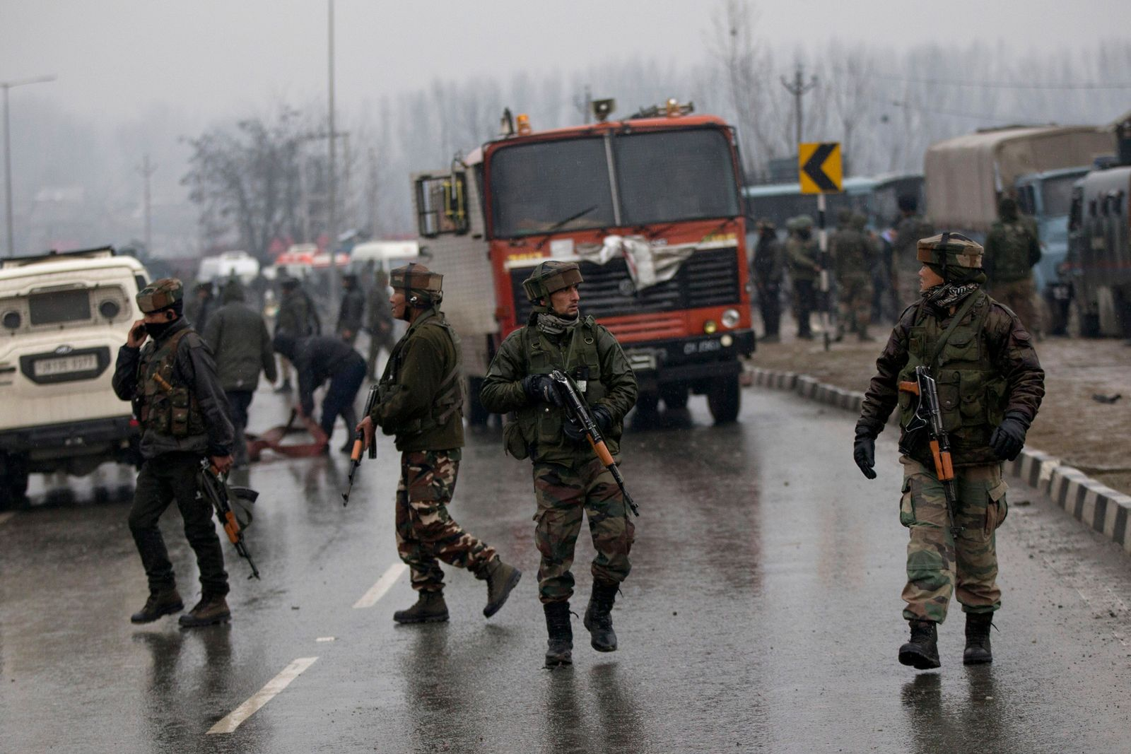 Indian paramilitary soldiers patrol at the site of an explosion in Pampore, Indian-controlled Kashmir, Thursday, Feb. 14, 2019. r. (AP Photo/Dar Yasin)