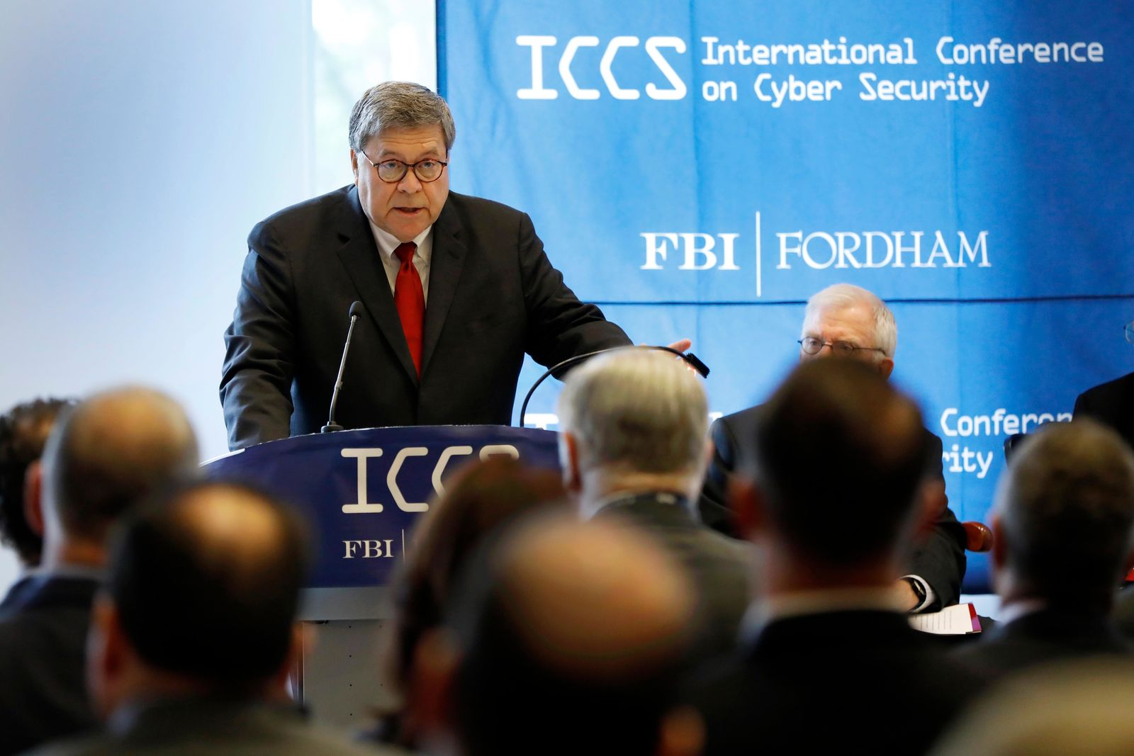 U.S. Attorney General William Barr addresses the International Conference on Cyber Security, hosted by the FBI and Fordham University, at Fordham University in New York, Tuesday, July 23, 2019. (AP Photo/Richard Drew)