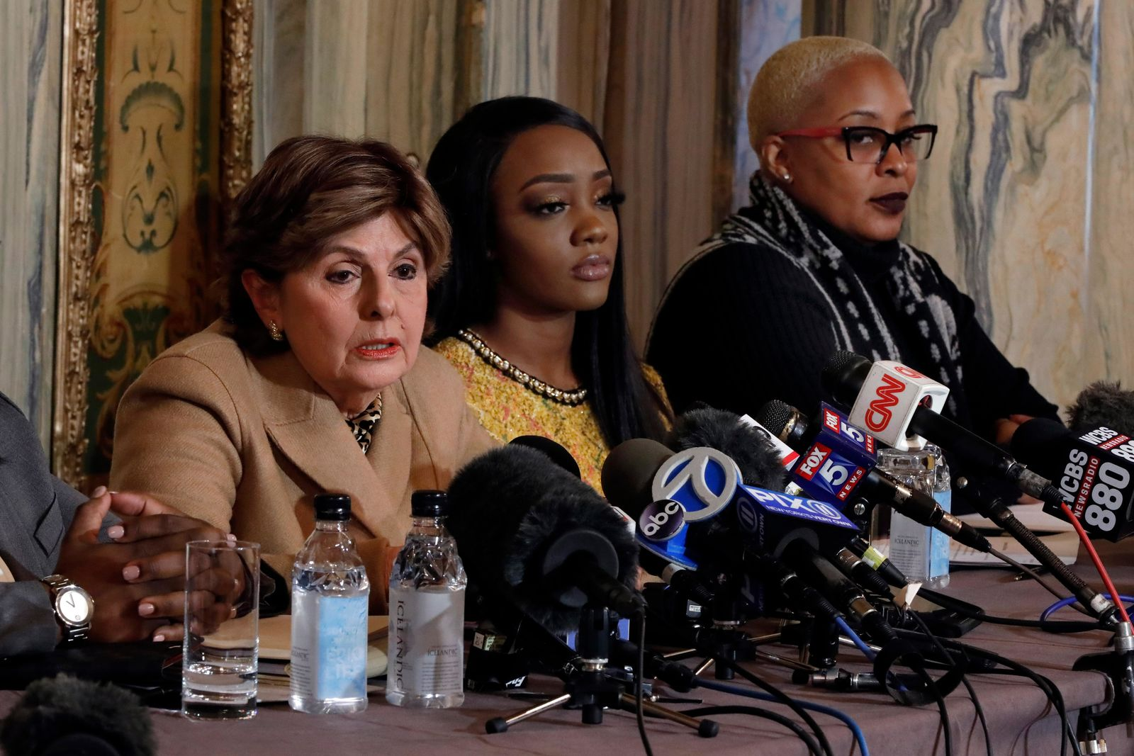 "Attorney Gloria Allred, left, Faith Rodgers, center, and Michelle Kramer, mother of Dominique Gardner, participate in a news conference about R&B singer R. Kelly in New York, Monday, Jan. 14, 2019. Kelly has been under fire since the recent airing of a Lifetime documentary ""Surviving R. Kelly ."" He has denied all allegations of sexual misconduct involving women and underage girls. (AP Photo/Richard Drew)"