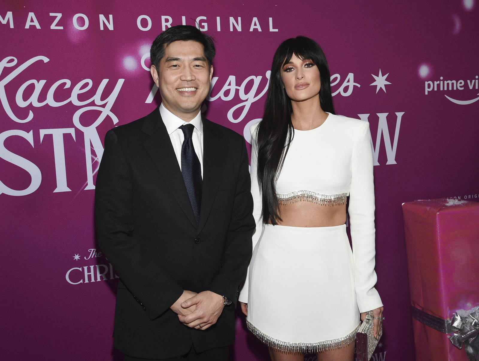 "Amazon Studios COO Albert Cheng, left, and singer-songwriter Kacey Musgraves attend the premiere of Amazon Prime Video's ""The Kacey Musgraves Christmas Show,"" at Metrograph, Tuesday, Nov. 19, 2019, in New York. (Photo by Evan Agostini/Invision/AP)"