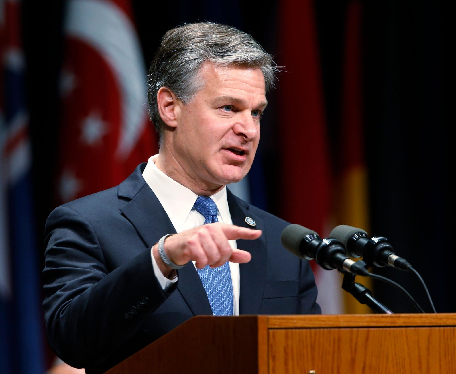 FILE - In this  June 7, 2019, file photo, Director of the Federal Bureau of Investigation, Christopher Wray, gestures as he speaks during a graduation ceremony for students of the Federal Bureau of Investigations National Academy at the FBI training facility in Quantico, Va. Wray is set to testify before a Senate committee in what could be a preview of the questioning special counsel Robert Mueller may face on Wednesday, July 24, 2019. (AP Photo/Steve Helber, File)