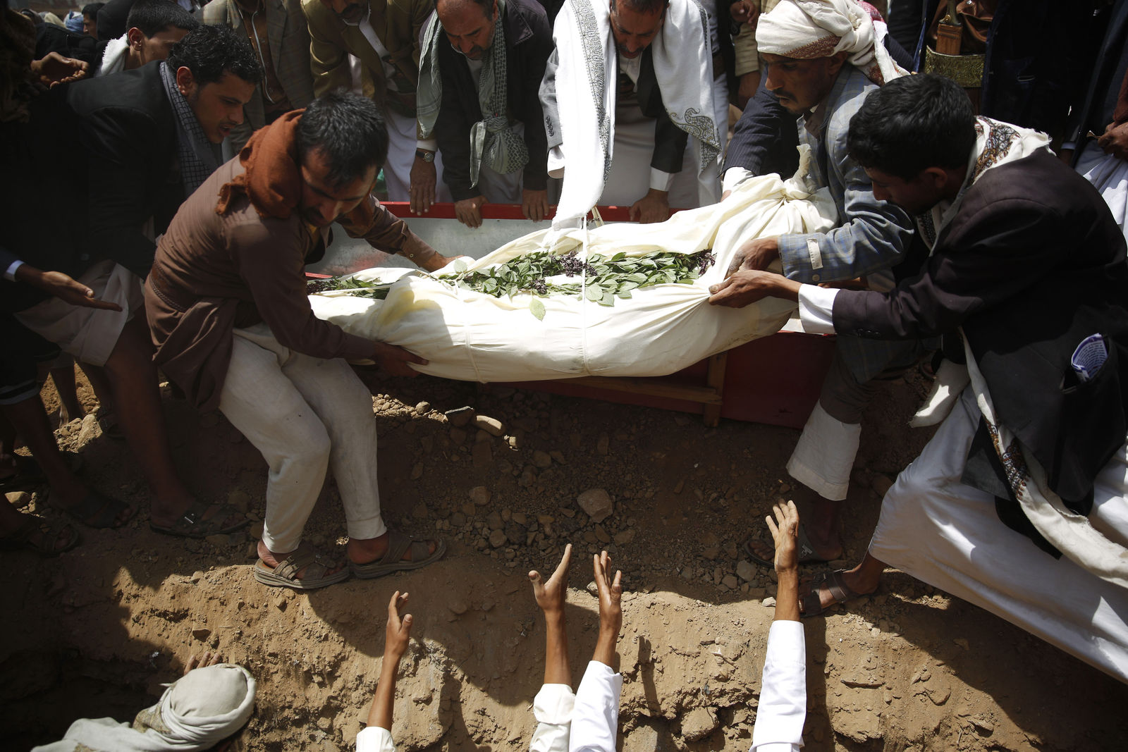 FILE -  Shiite rebels known as Houthis bury a fellow Houthi, who was killed in a suicide bomb attack, during his funeral in Sanaa, Yemen, Friday, Sept. 4, 2015.{ } (AP Photo/Hani Mohammed)