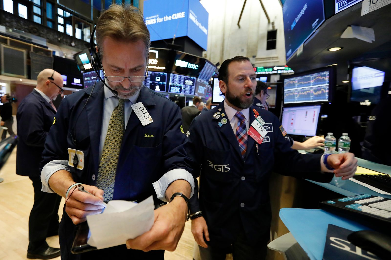 Trader Ronald Madarasz, left, and specialist Michael Pistillo work on the floor of the New York Stock Exchange, Thursday, Jan. 10. (AP Photo/Richard Drew)