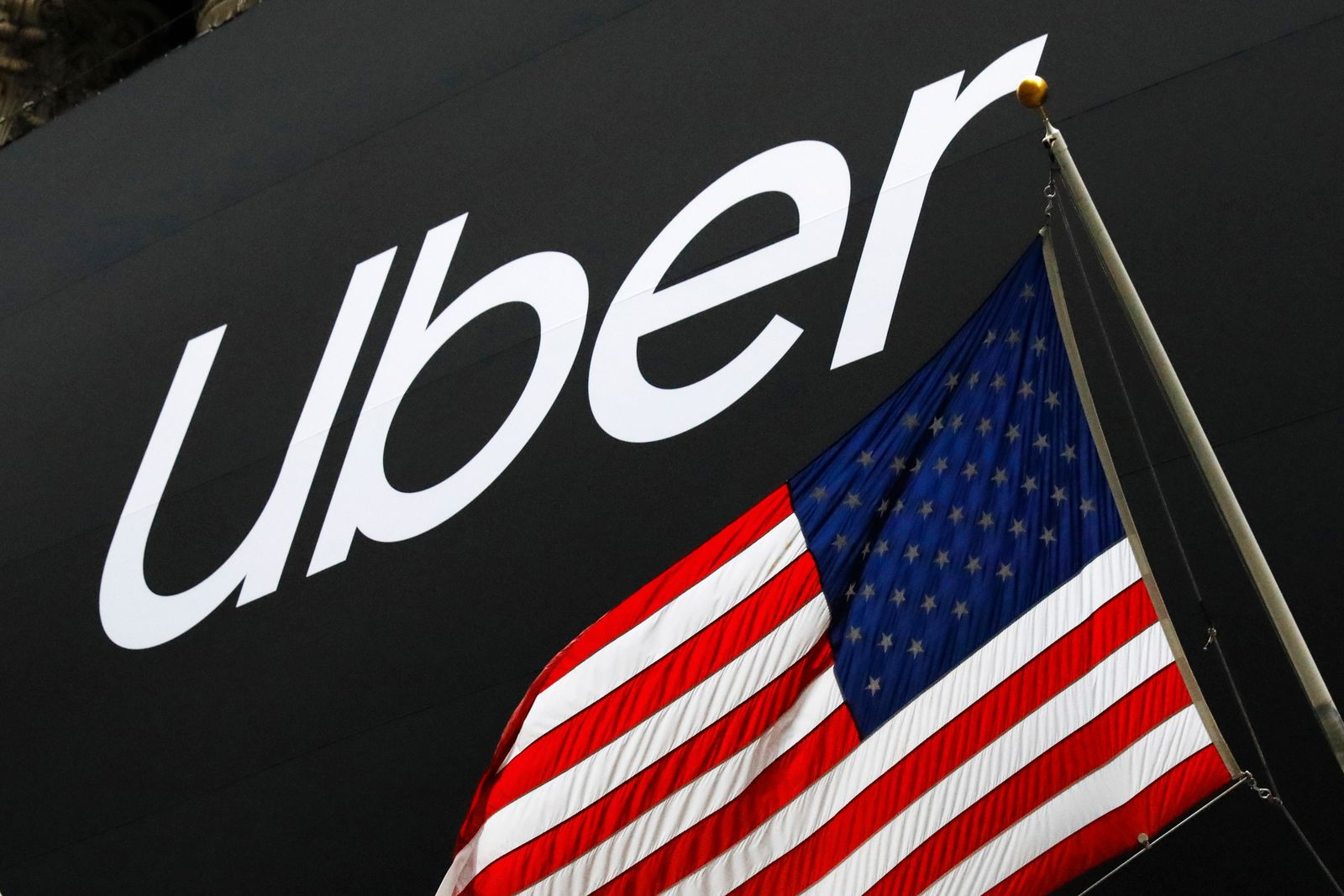 A banner for Uber is draped on the front of the New York Stock Exchange before the world's largest ride-hailing service holds its initial public offering, Friday, May 10, 2019. (AP Photo/Mark Lennihan)