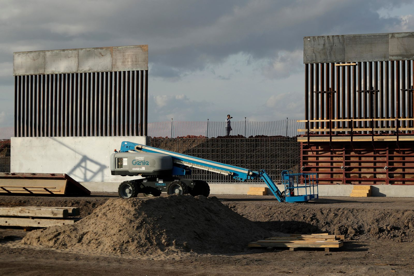 FILE - In this Nov. 7, 2019, file photo, the first panels of levee border wall are seen at a construction site along the U.S.-Mexico border, in Donna, Texas. Major construction projects moving forward along the U.S. borders with Canada and Mexico amid the coronavirus pandemic are raising fears workers could spread the sickness within nearby communities. (AP Photo/Eric Gay, File)