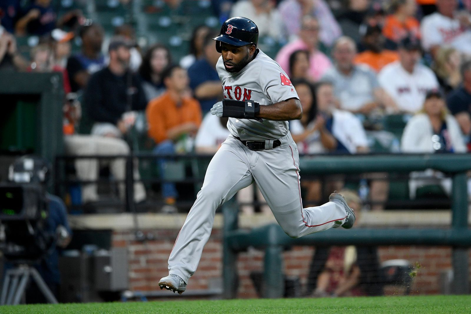 Boston Red Sox's Jackie Bradley Jr. runs toward home to score during the fourth inning of a baseball game against the Baltimore Orioles, Friday, June 14, 2019, in Baltimore. (AP Photo/Nick Wass)