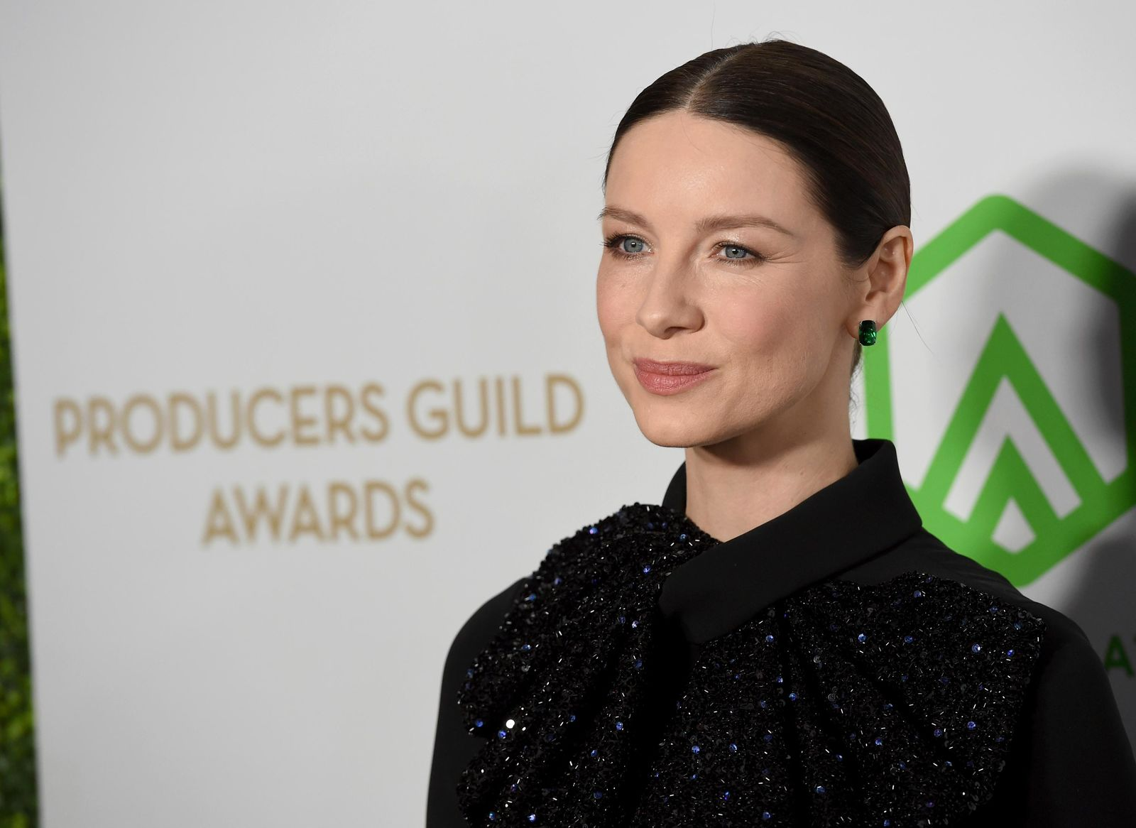 Caitriona Balfe arrives at the 2020 Producers Guild Awards at the Hollywood Palladium on Saturday, Jan. 18, 2020, in Los Angeles, Calif. (AP Photo/Chris Pizzello)