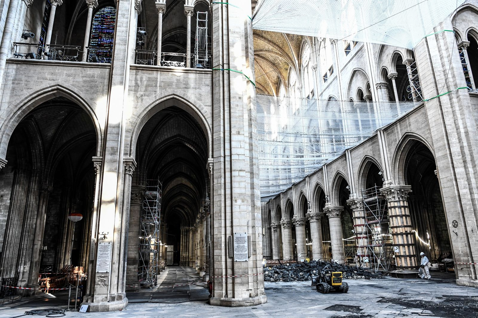 Damage on the nave and rubble during preliminary work are pictured in the Notre-Dame de Paris Cathedral three months after a major fire Wednesday, July 17, 2019 in Paris. The chief architect of France's historic monuments says that three months after the April 15 fire that devastated Notre Dame Cathedral the site is still being secured. (Stephane de Sakutin/Pool via AP)