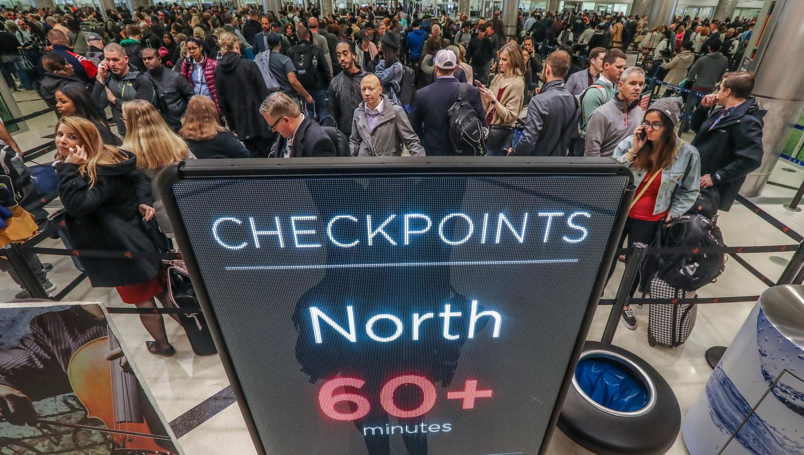Security lines at Hartsfield-Jackson International Airport in Atlanta stretch more than an hour long amid the partial federal shutdown, causing some travelers to miss flights, Monday morning, Jan. 14, 2019. (John Spink/Atlanta Journal-Constitution via AP)