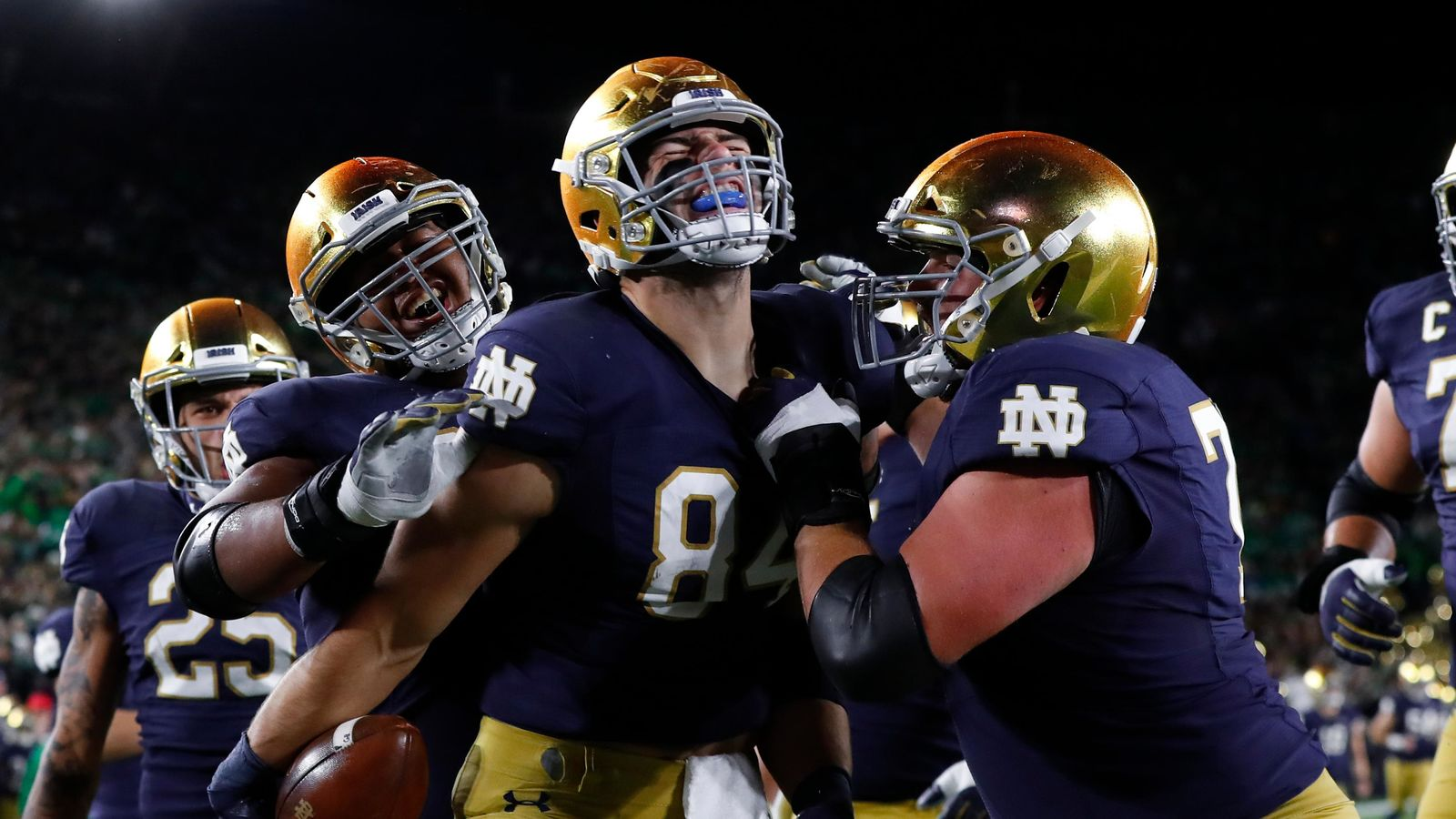 Notre Dame tight end Cole Kmet (84) celebrates his 10-yard touchdown catch against Southern California in the first half of an NCAA college football game in South Bend, Ind., Saturday, Oct. 12, 2019. (AP Photo/Paul Sancya)