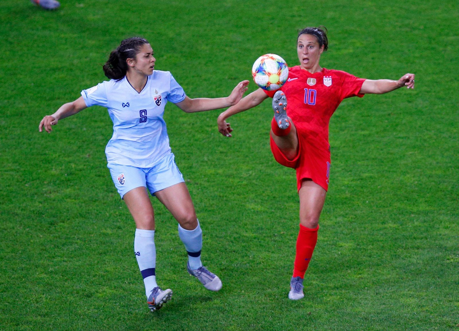 United States' Carli Lloyd attempts to control the ball as Thailand's Miranda Nild , left, watches during the Women's World Cup Group F soccer match between the United States and Thailand at the Stade Auguste-Delaune in Reims, France, Tuesday, June 11, 2019. (AP Photo/Francois Mori)
