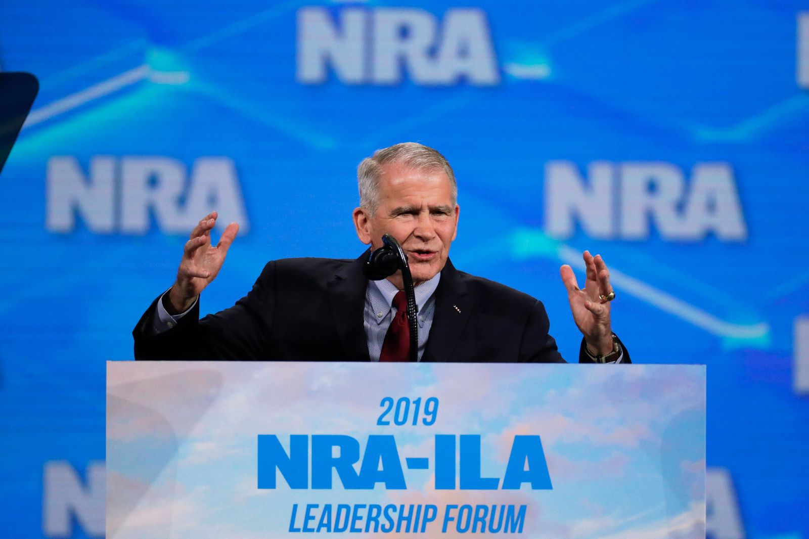 In this Friday, April 26, 2019 photo, National Rifle Association President Col. Oliver North speaks at the National Rifle Association Institute for Legislative Action Leadership Forum in Lucas Oil Stadium in Indianapolis.{ } (AP Photo/Michael Conroy)