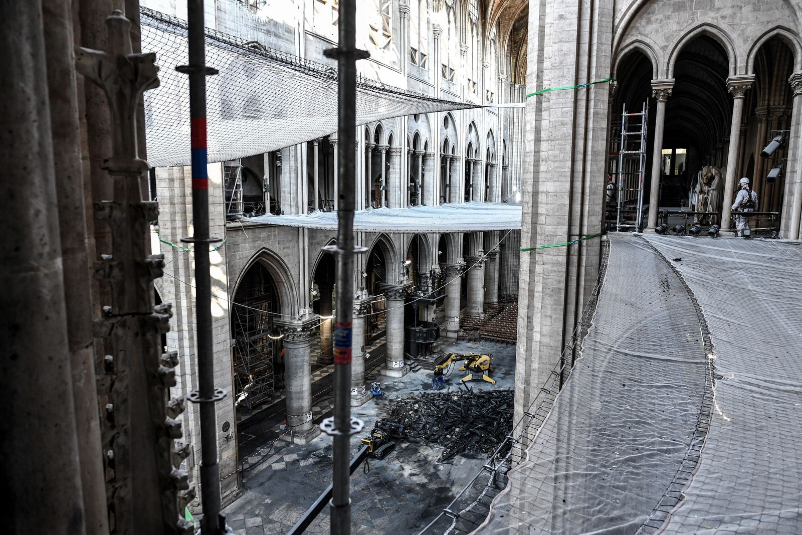 Damage on the nave and rubble are pictured during preliminary work in the Notre-Dame de Paris Cathedral three months after a major fire Wednesday, July 17, 2019 in Paris. The chief architect of France's historic monuments says that three months after the April 15 fire that devastated Notre Dame Cathedral the site is still being secured. (Stephane de Sakutin/Pool via AP)
