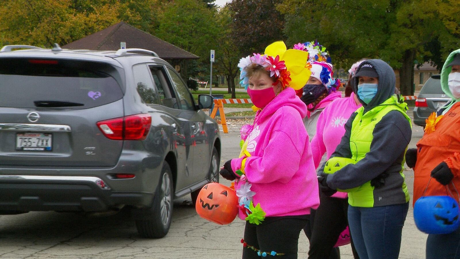 Volunteers wait to hand out candy at the{ }Truck or Treat event in Menomonie Park Zoo (courtesy: WLUK)