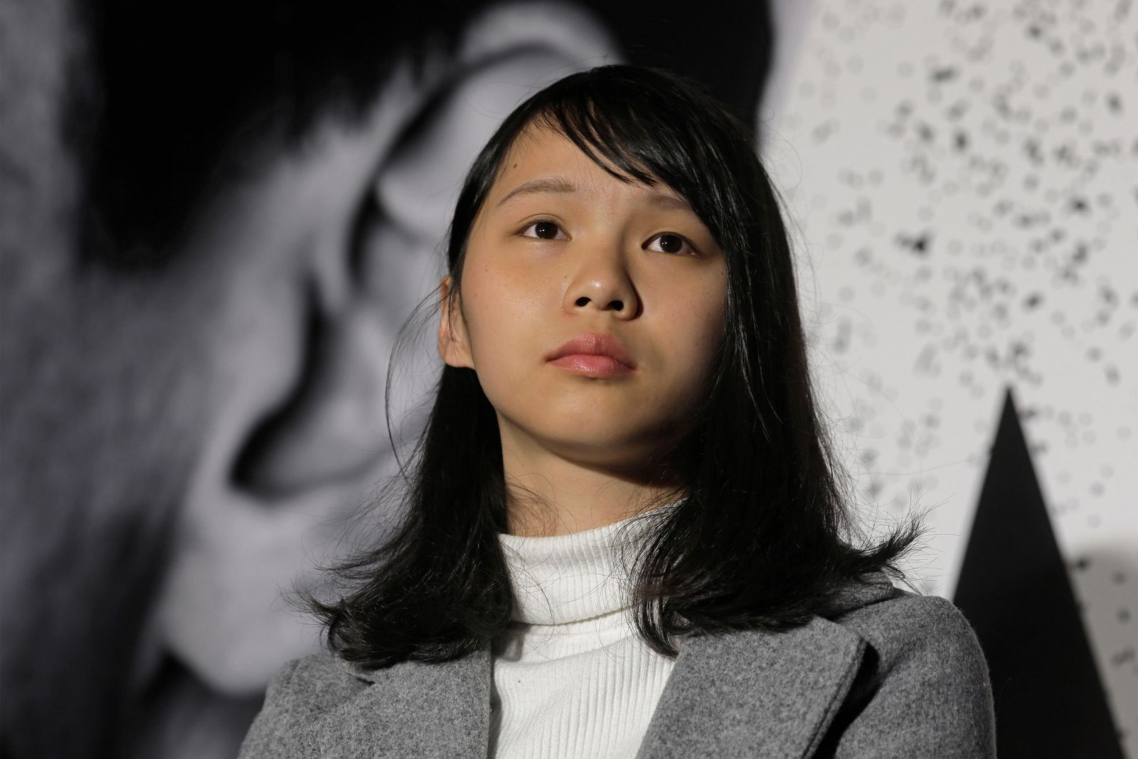 FILE - In this  Jan. 28, 2018, file photo, Agnes Chow, a member of democracy activist Joshua Wong's Demosisto party, attends a protest in Hong Kong. .  (AP Photo/Vincent Yu, File)