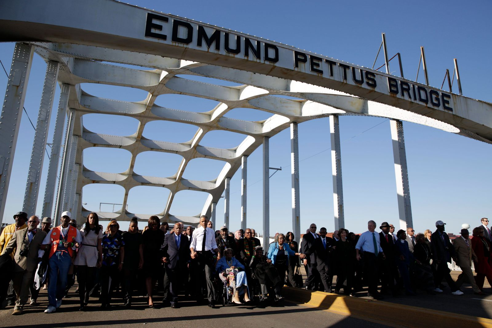 President Barack Obama, First Lady Michelle Obama, Marian Robinson, Malia and Sasha Obama, join Rep. John Lewis, former President George W. Bush, former First Lady Laura Bush, former foot soldiers and other dignitaries in marching across the Edmund Pettus Bridge to commemorate the 50th Anniversary of Bloody Sunday in Selma, Alabama, March 7, 2015.(Official White House Photo by Pete Souza via National Archives)