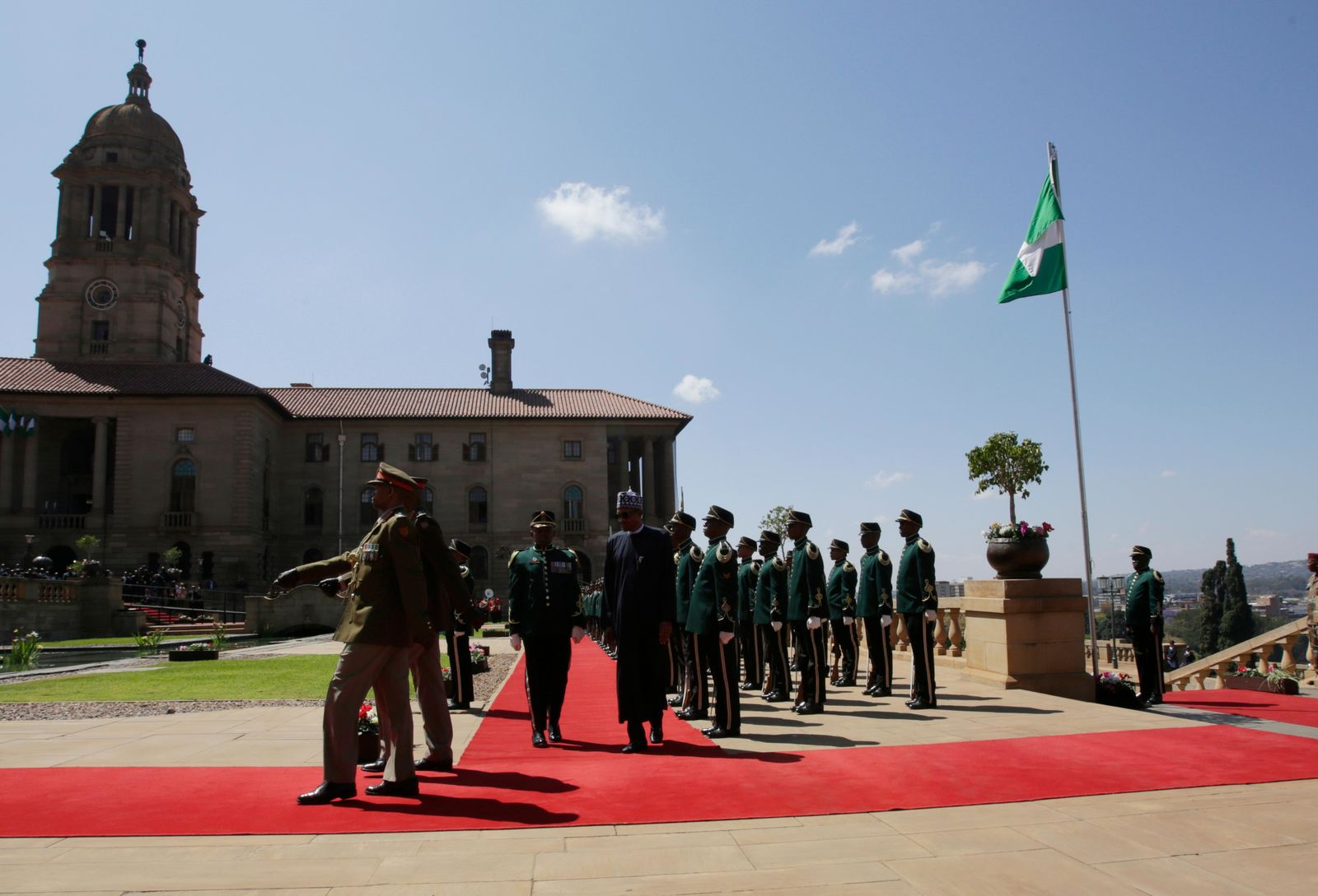 Nigerian President Muhammadu Buhari inspects a guard of honour at a welcoming ceremony in Pretoria, South Africa Thursday, Oct. 3, 2019.{ } (AP Photo/Themba Hadebe)