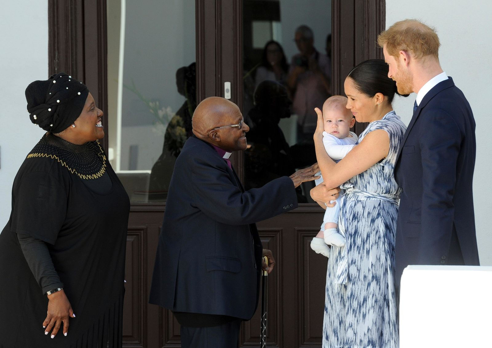 FILE - In this Wednesday, Sept. 25, 2019 file photo, Britain's Prince Harry and Meghan, Duchess of Sussex, holding their son Archie, meet Anglican Archbishop Emeritus, Desmond Tutu and his wife Leah in Cape Town, South Africa. (Henk Kruger/Pool via AP, File)