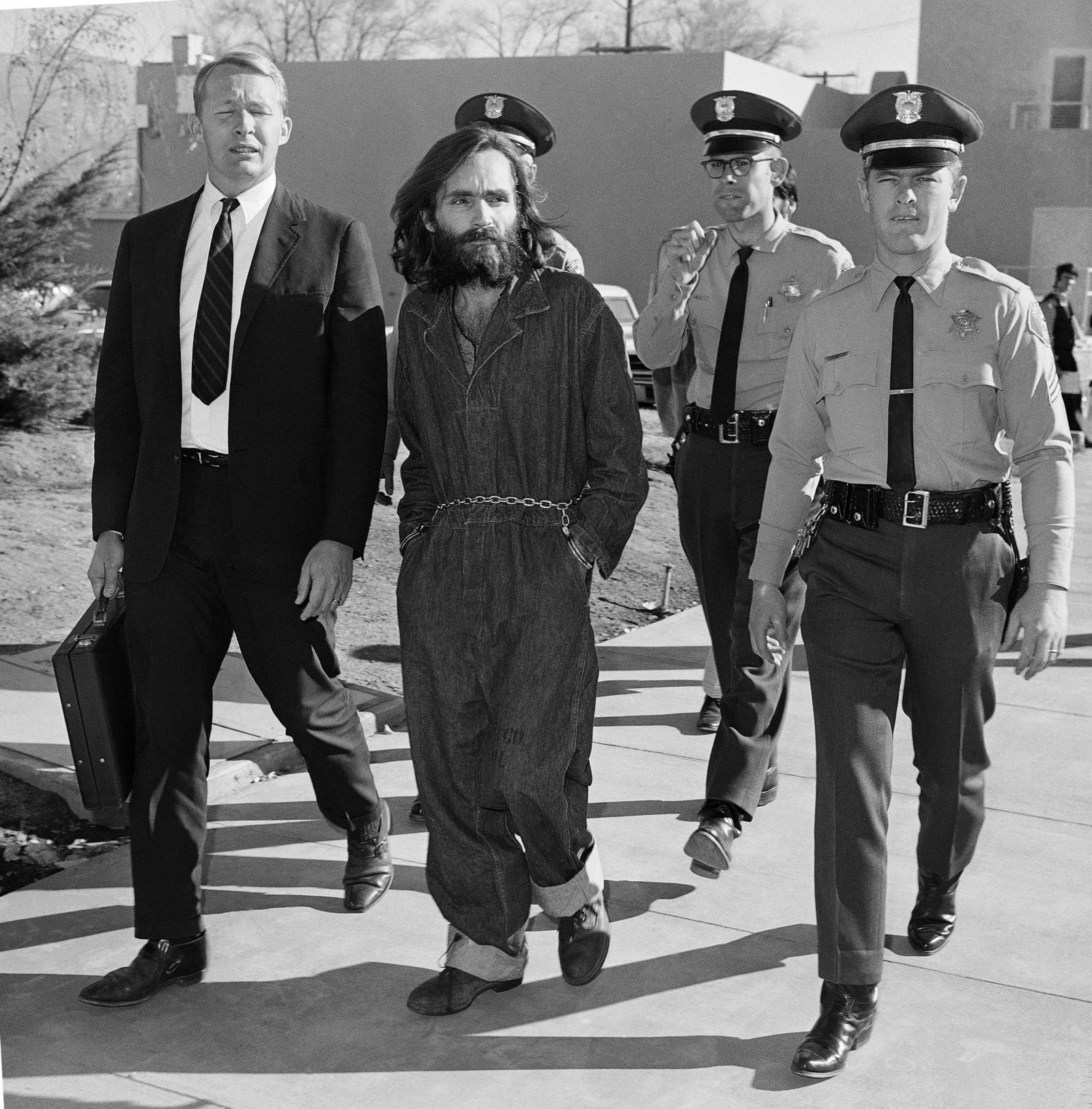 FILE - This Dec. 3, 1969, file photo shows Charles Manson en route to court in Independence, Calif., following his arrest at nearby Barker Ranch.{ } (AP Photo/Harold Filan, File)
