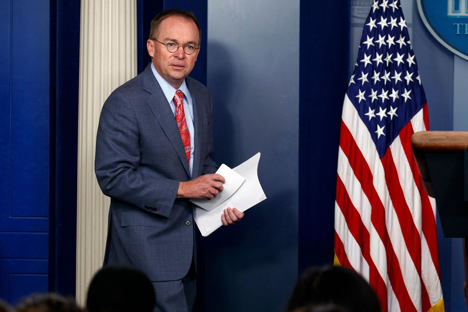 FILE - In this Thursday, Oct. 17, 2019, file photo, White House chief of staff Mick Mulvaney arrives to a news conference, in Washington. al meeting at his own golf club, although the president has now dropped that plan. (AP Photo/Evan Vucci, File)