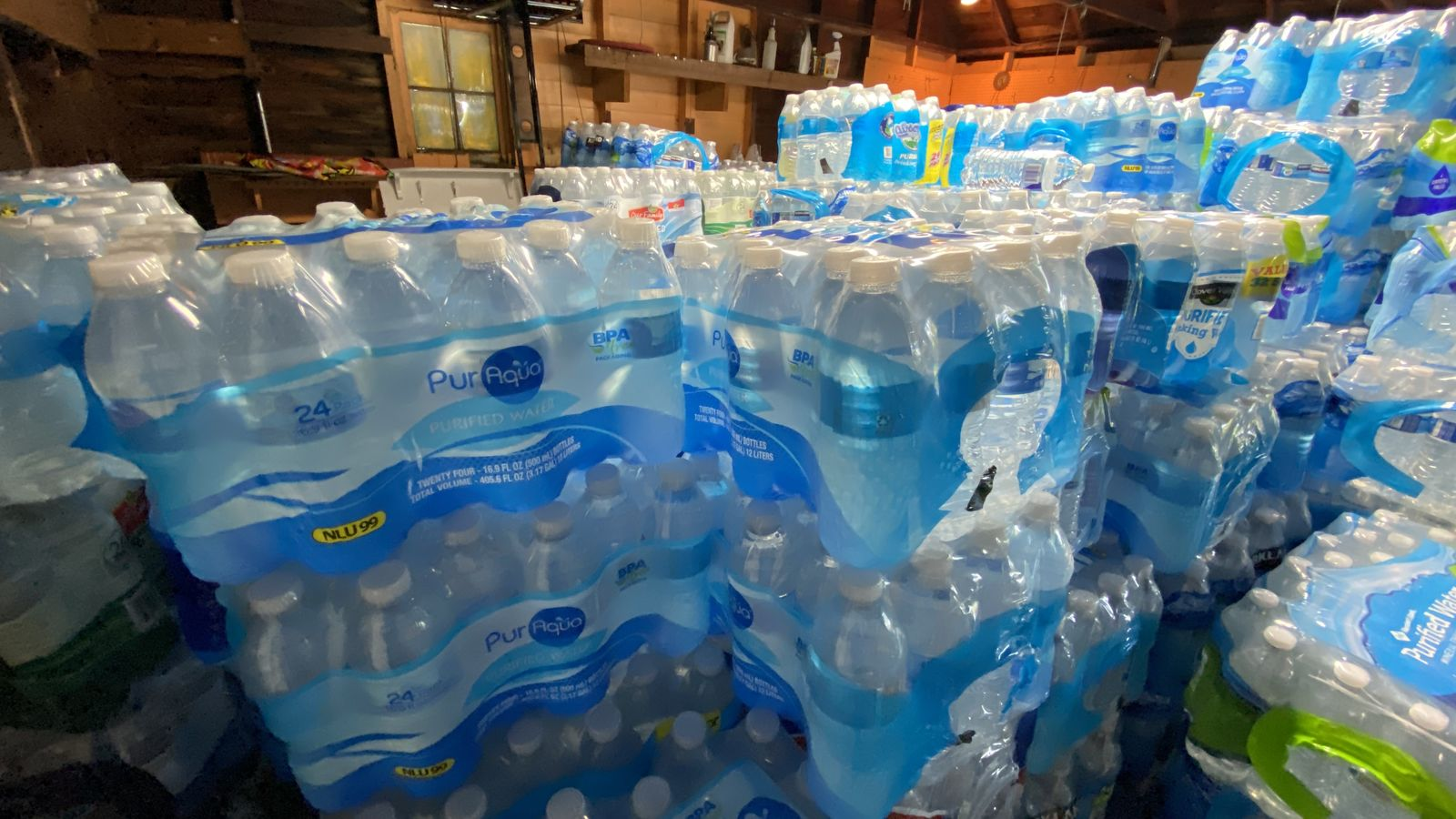 Tamara Custard started filling her garage with cases July 16, 2020. She has been receiving water from community members as well as area businesses.{ }(WWM/Jason Heeres)