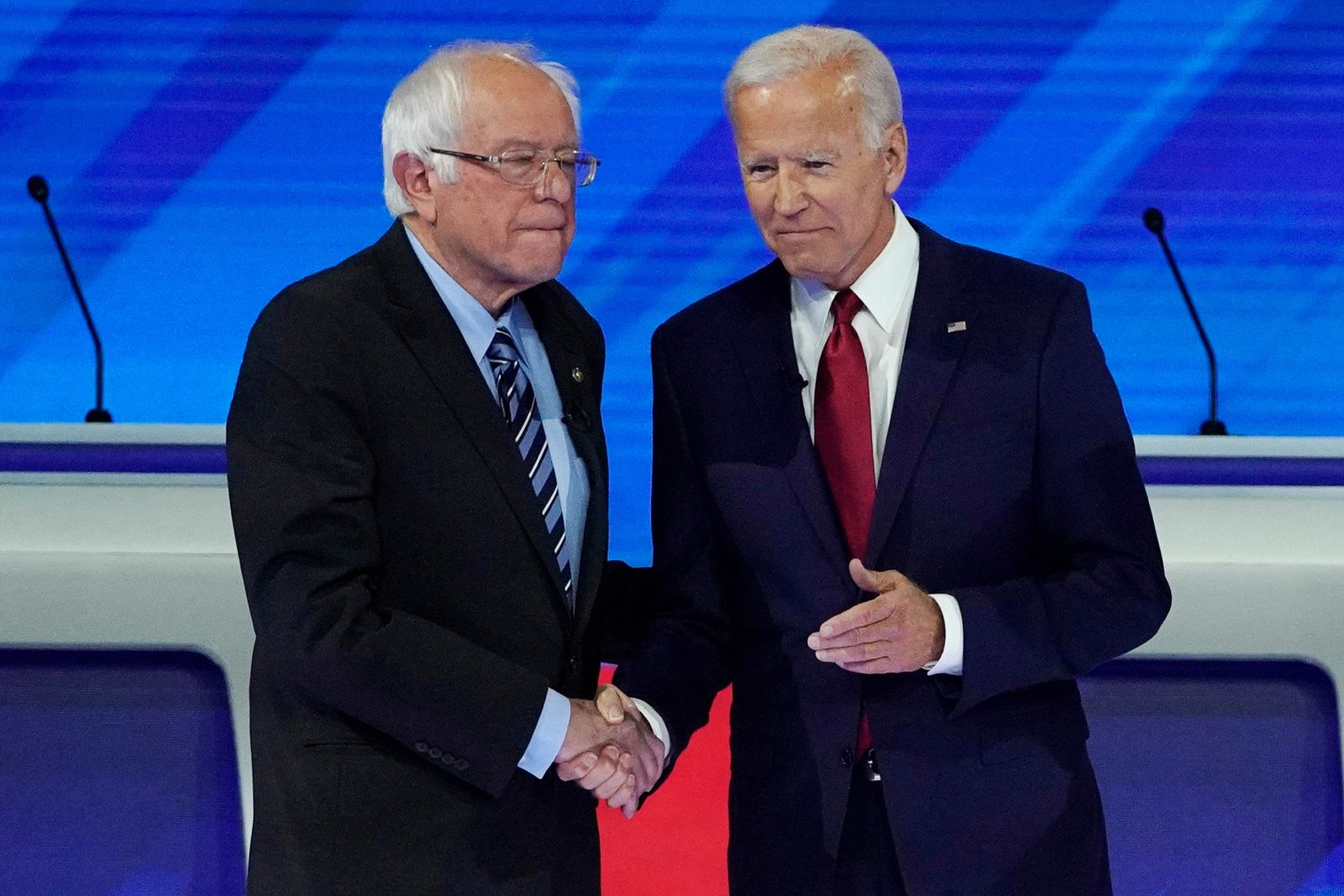 Democratic presidential candidates Sen. Bernie Sanders, I-Vt., left, and former Vice President Joe Biden greet each other Thursday, Sept. 12, 2019, before a Democratic presidential primary debate hosted by ABC at Texas Southern University in Houston. (AP Photo/David J. Phillip)