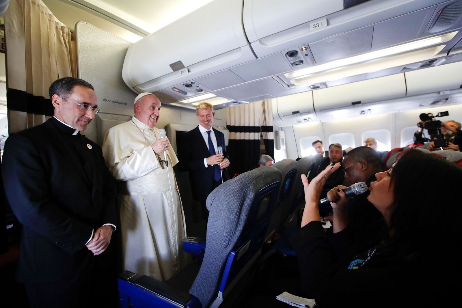 Pope Francis listens reporters questions during his flight from Antamanarivo to Rome, Tuesday, Sept. 10, 2019, after his seven-day pastoral trip to Mozambique, Madagascar, and Mauritius. (AP Photo/Alessandra Tarantino)