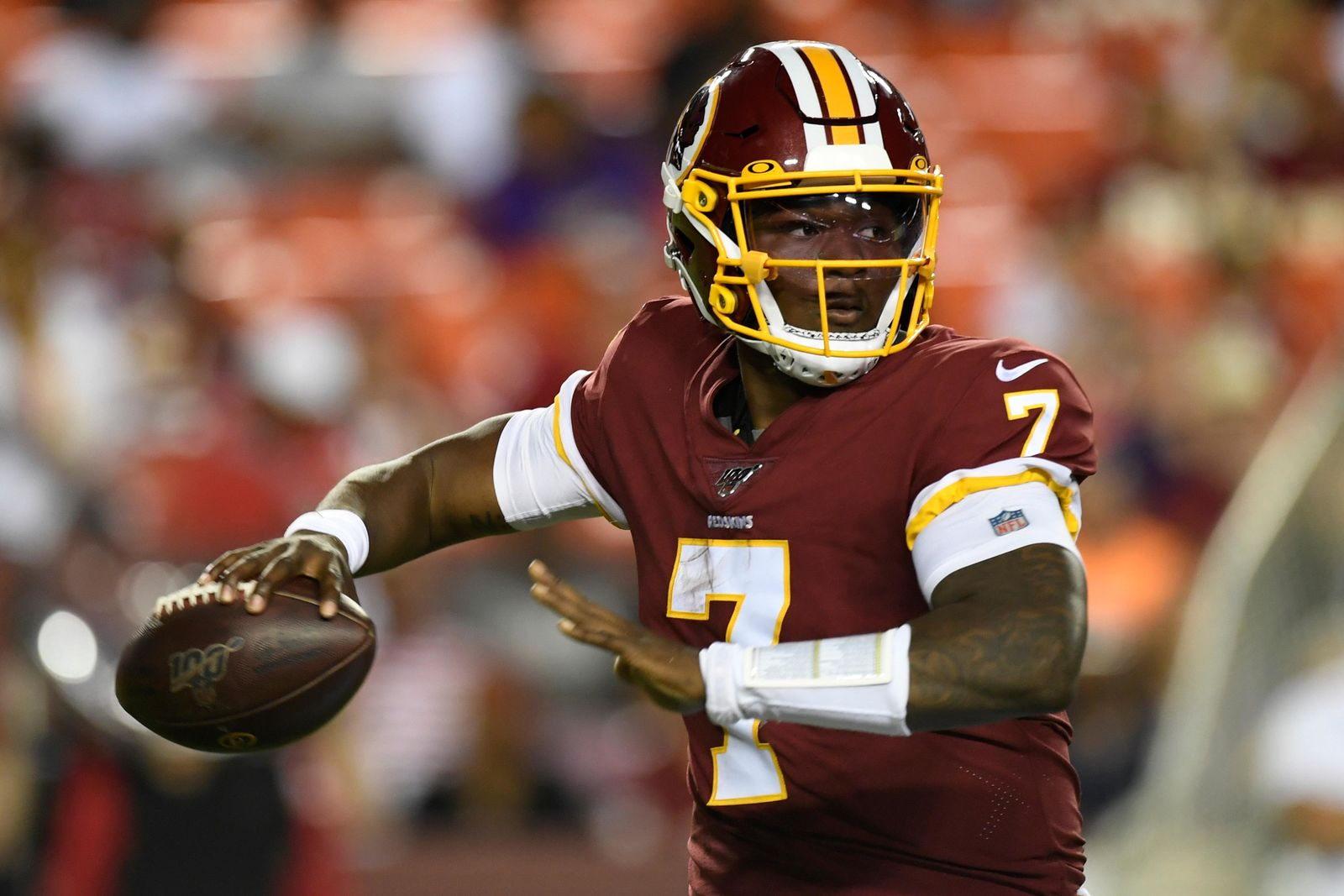 Washington Redskins quarterback Dwayne Haskins looks for an opening during the first half of an NFL preseason football game against the Baltimore Ravens at FedEx Field in Landover, Md., Thursday, Aug. 29, 2019. (AP Photo/Susan Walsh)