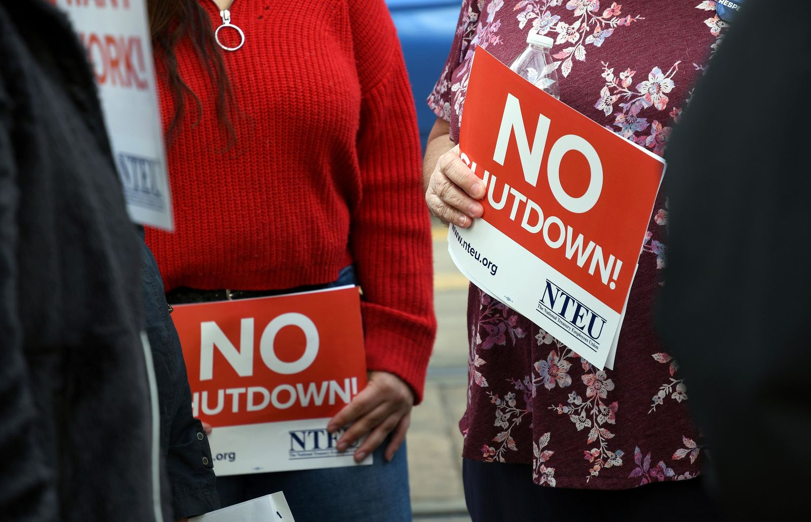 People protest the partial government shutdown in downtown Denver on Thursday, Jan. 10, 2019. Federal workers are scaling back spending, canceling trips, applying for unemployment benefits, seeking second jobs and taking out loans to stay afloat, with no end in sight for a shutdown that enters its 21st day Friday, and will be the longest in history by this weekend. (AP Photo/Thomas Peipert)