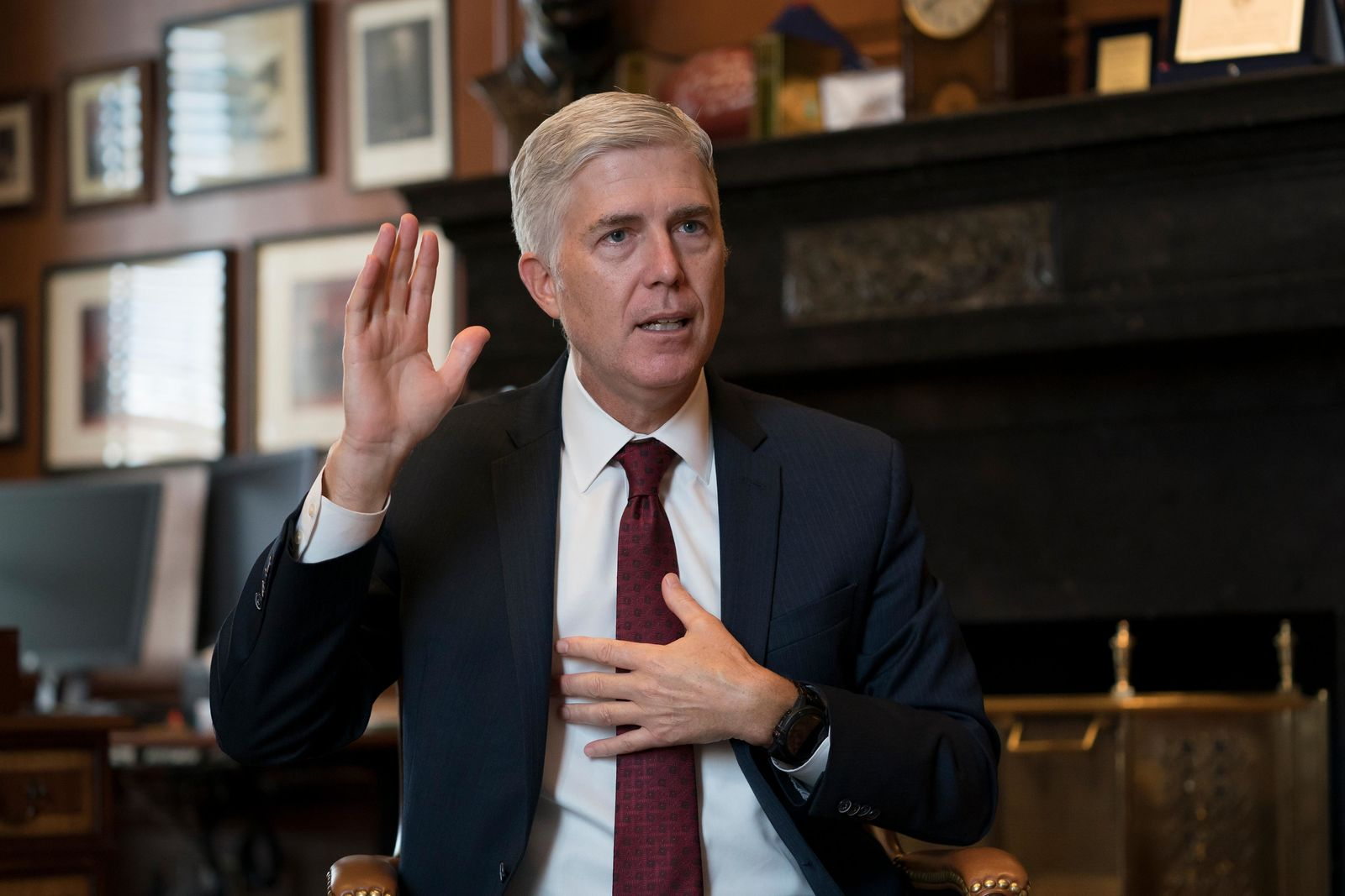 Associate Justice Neil Gorsuch, President Donald Trump's first appointee to the high court, speaks to The Associated Press about events that have influenced his life and the loss of civility in public discourse, in his chambers at the Supreme Court in Washington, Wednesday, Sept. 4, 2019. (AP Photo/J. Scott Applewhite)
