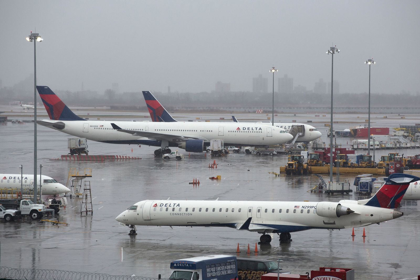 FILE- In this March 2, 2018, file photo, Delta Air Lines planes are grounded in New York. Delta Air Lines reports earns on Thursday, July 12. (AP Photo/Mark Lennihan, File)