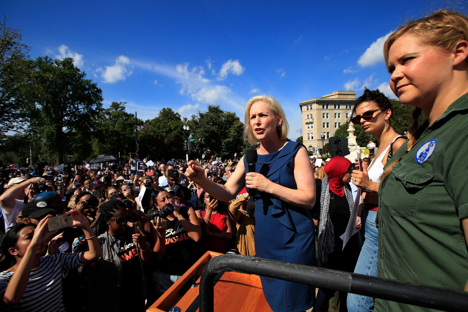 Sen. Kirsten Gillibrand, D-N.Y., with actress and comedian Amy Schumer, right, and actress model Emily Ratajkowski, center, speaks at a rally against Supreme Court nominee Brett Kavanaugh at the Supreme Court in Washington, Thursday, Oct. 4, 2018. (AP Photo/Manuel Balce Ceneta)
