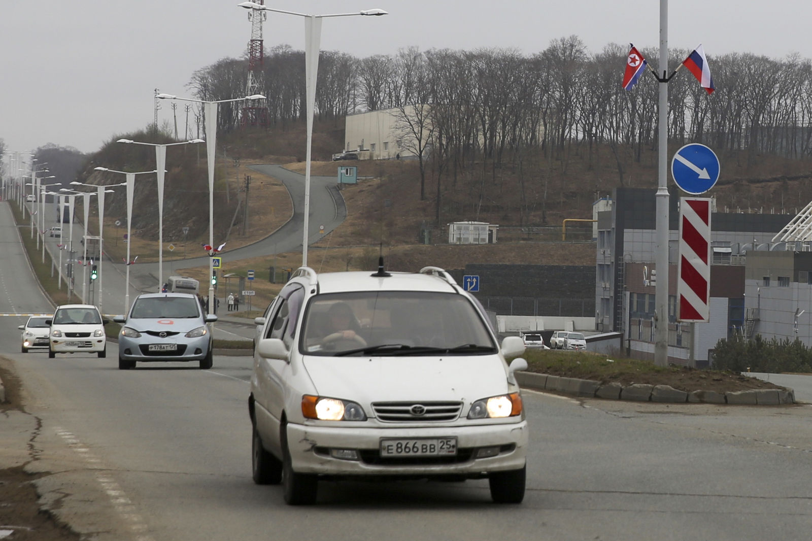 Flags of Russia and North Korea are seen along the road on Russky Island, in Vladivostok, Russia, Tuesday, April 23, 2019. Russian President Vladimir Putin will meet with North Korean leader Kim Jong Un for a much-anticipated summit on Thursday April 25, a Kremlin adviser said, putting an end to weeks of speculation about when and where it would take place. (AP Photo/Mari Borodina)