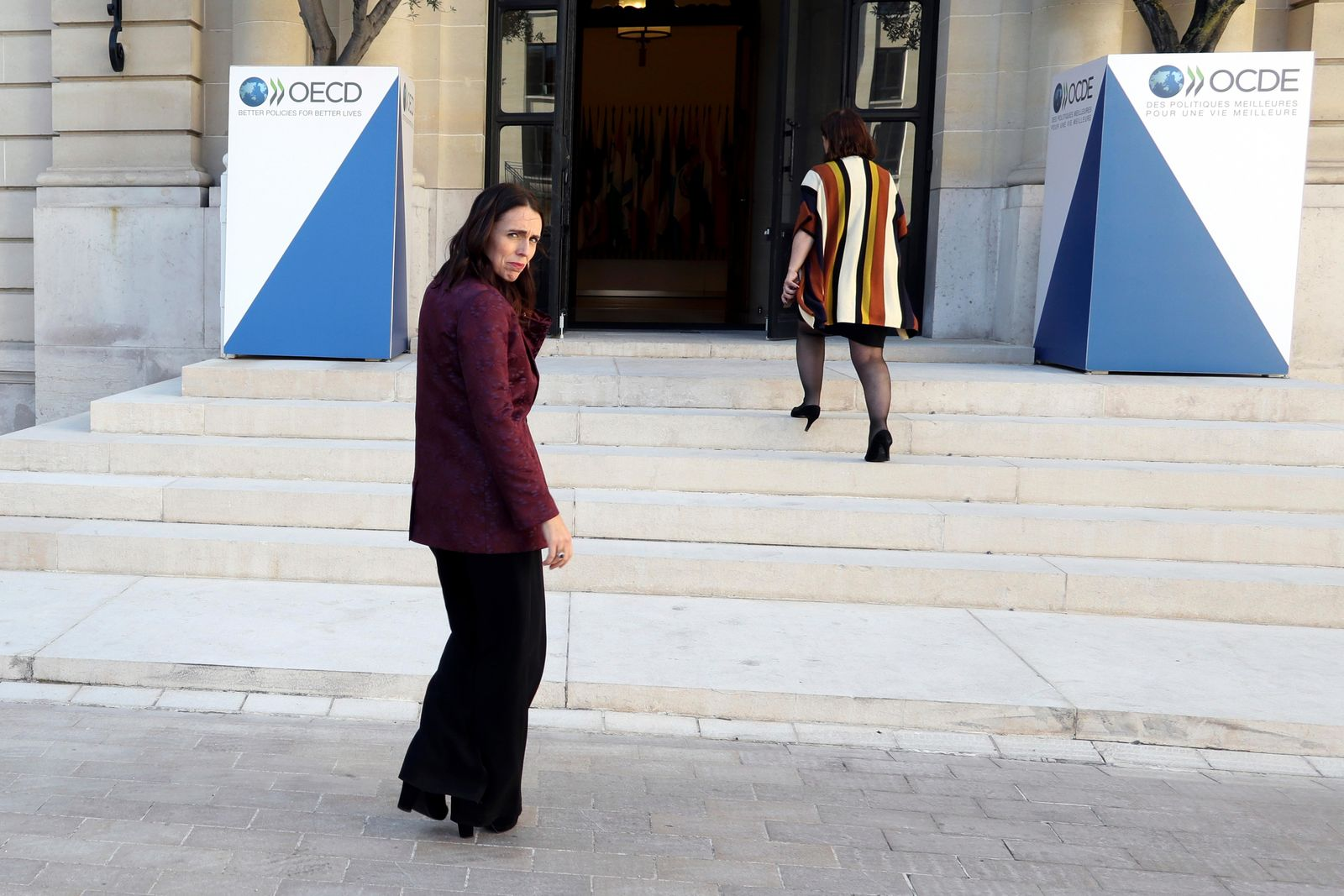 New Zealand Prime Minister Jacinda Ardern, left, leaves after a press conference, at the OECD headquarters, in Paris, Tuesday, May 14, 2019.{ } (AP Photo/Thibault Camus)