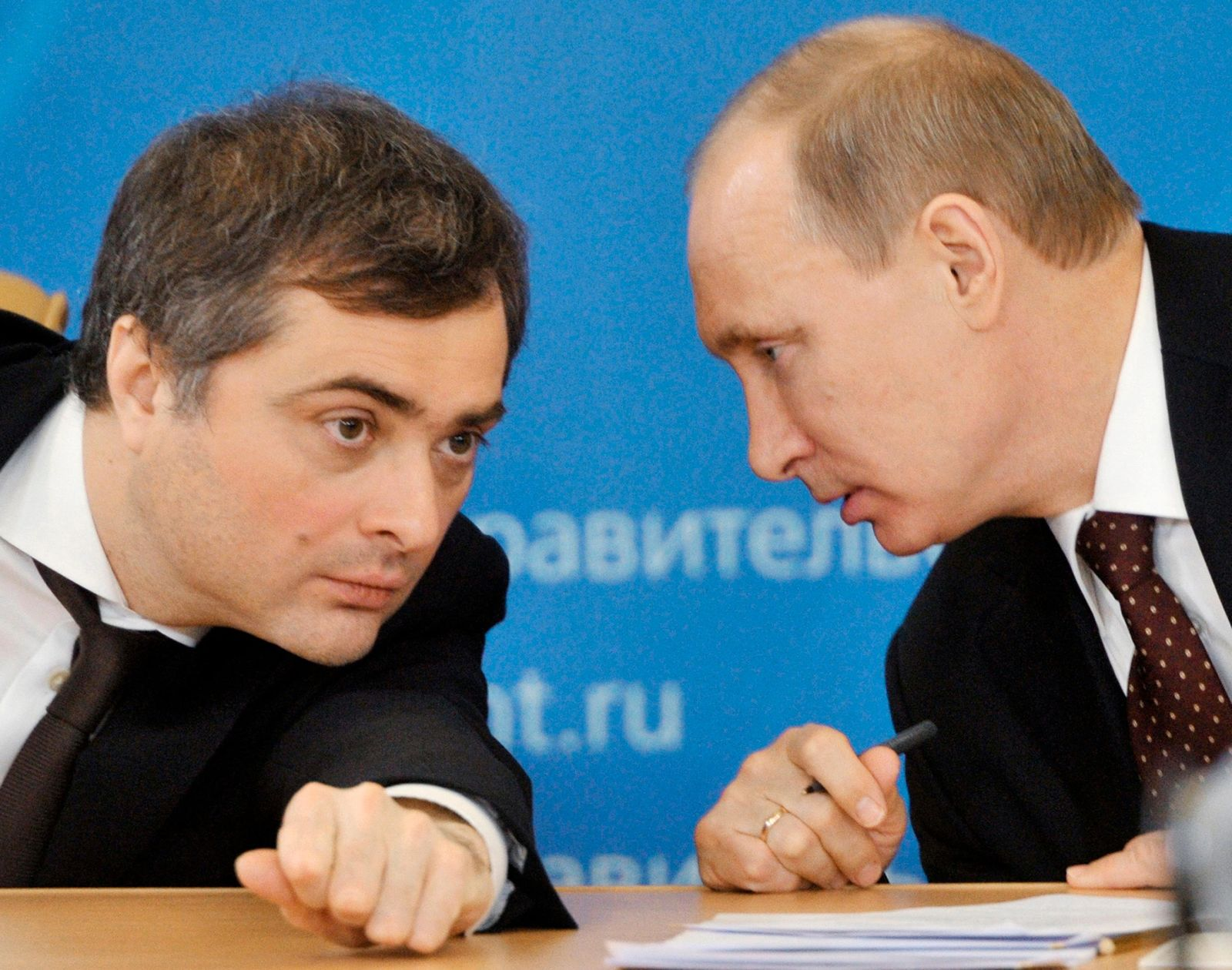 FILE In this file photo taken on Tuesday, March 18, 2014, Russian Prime Minister Vladimir Putin, right, speaks to Vladislav Surkov, deputy prime minister in charge of economic modernization, during a visit in Kurgan, Russia (Alexei Nikolsky, Sputnik, Kremlin Pool Photo via AP, File)