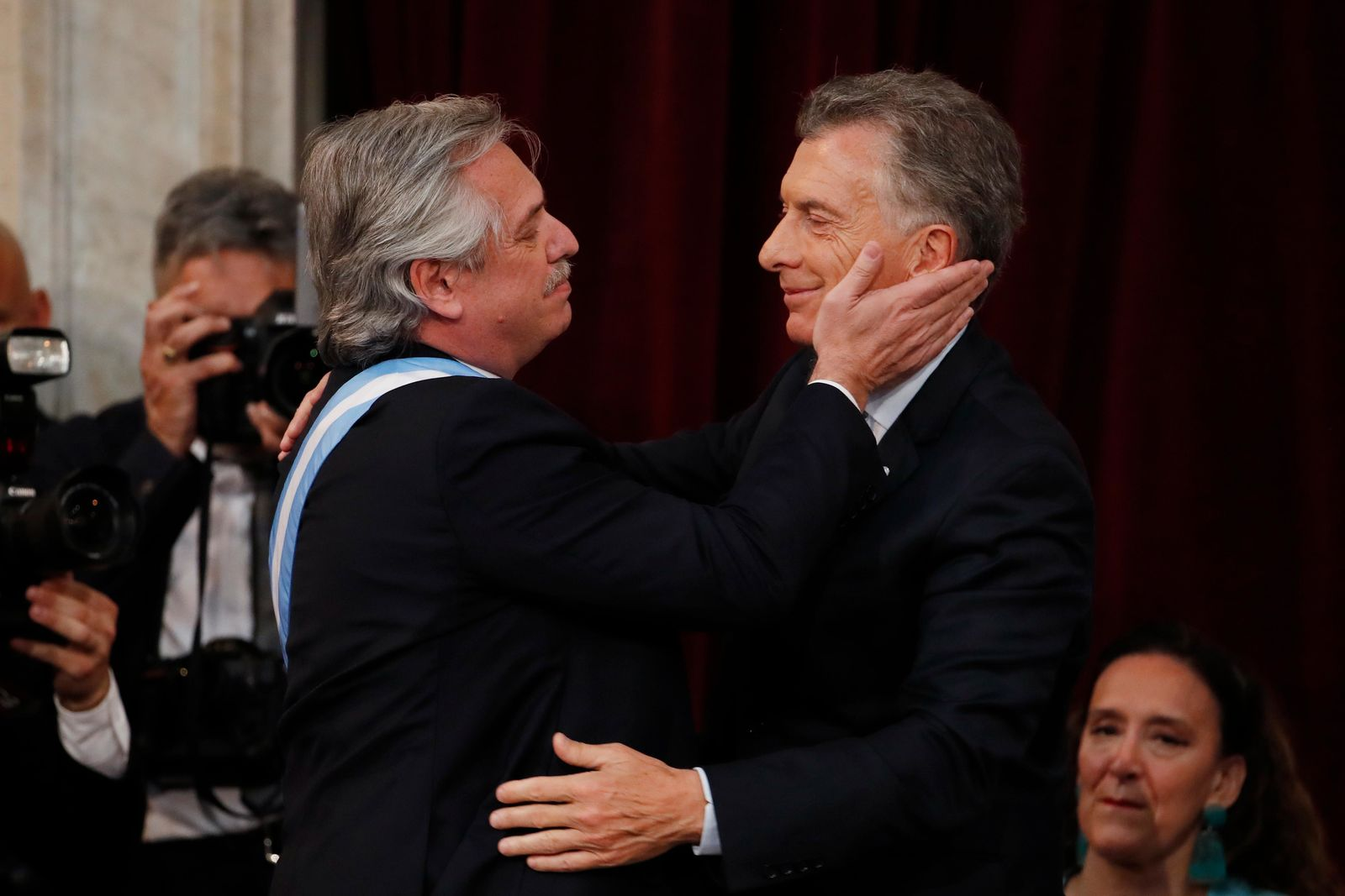 Argentina's new President Alberto Fernandez, left, embraces outgoing president Mauricio Macri after taking the oath of office at the Congress in Buenos Aires, Argentina, Tuesday, Dec. 10, 2019. (AP Photo/Natacha Pisarenko)