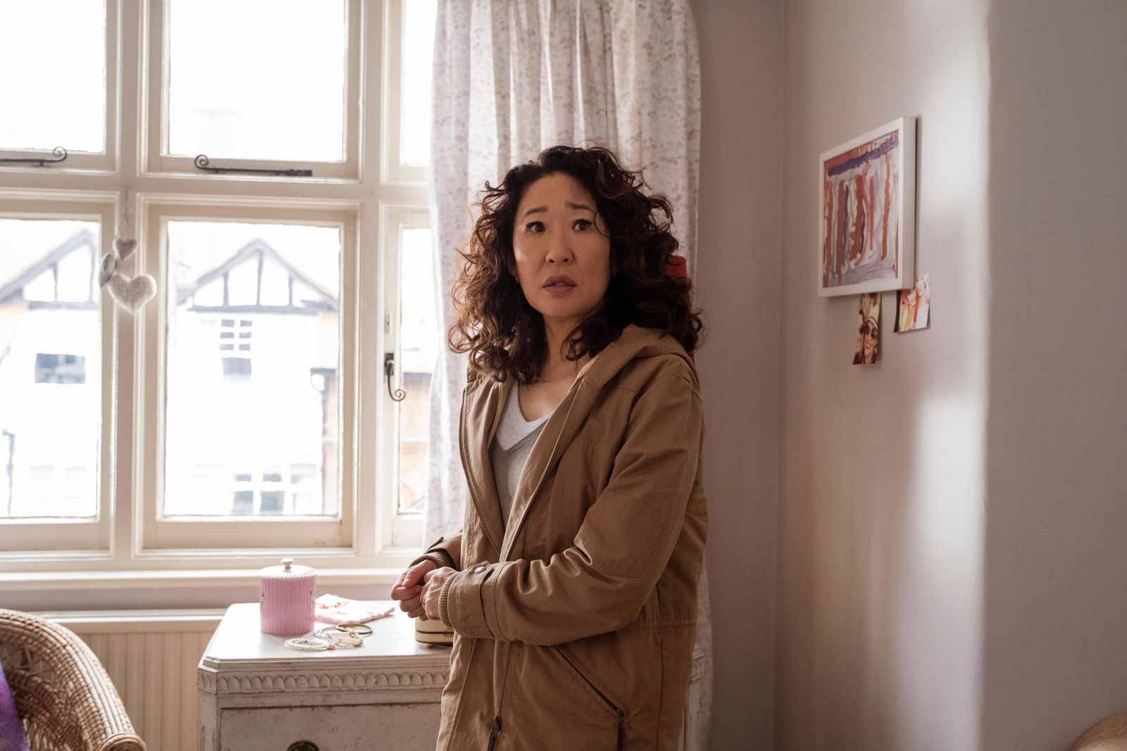 "This image released by BBC America shows Sandra Oh in a scene from ""Killing Eve:""  Oh is nominated for an Emmy Award for outstanding lead actress in a drama series. (Nick Wall/BBCAmerica via AP)"