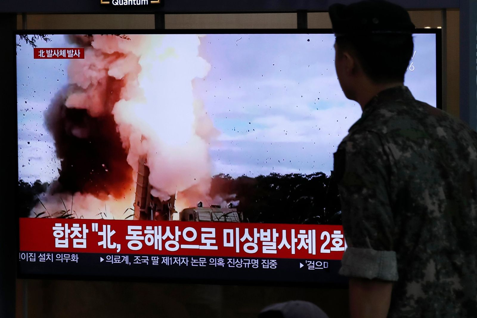"A South Korean soldier watches a TV screen showing a news program reporting about North Korea's firing projectiles with a file image at the Seoul Railway Station in Seoul, South Korea, Saturday, Aug. 24, 2019. North Korea fired two suspected short-range ballistic missiles off its east coast on Saturday in the seventh consecutive week of weapons tests, South Korea's military said, a day after it threatened to remain America's biggest threat in protest of U.S.-led sanctions on the country. The Korean letters on TV read: ""North Korea fired projectiles."" (AP Photo/Lee Jin-man)"