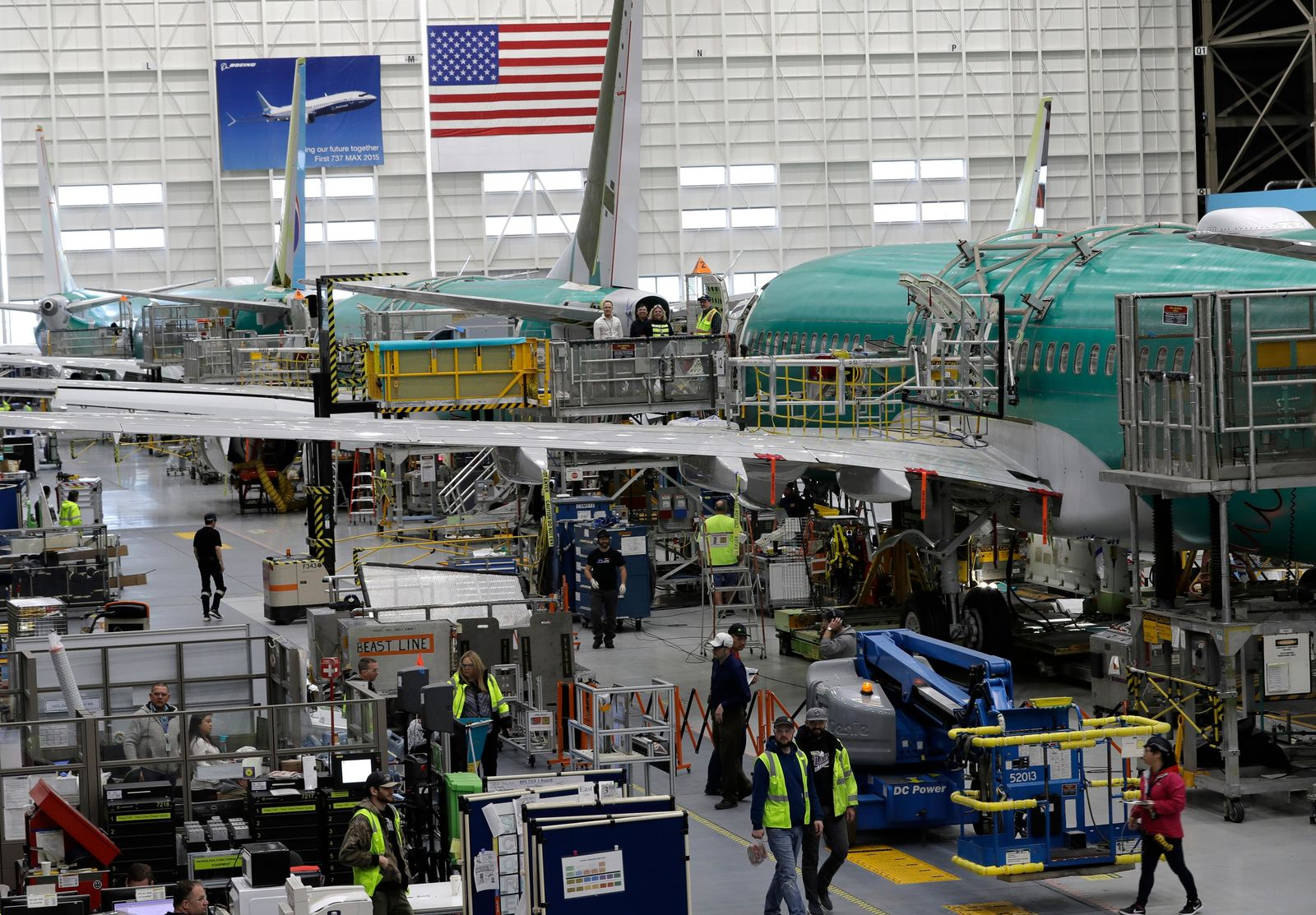 FILE - In this March 27, 2019, file photo people work on the Boeing 737 MAX 8 assembly line during a brief media tour in Boeing's 737 assembly facility in Renton, Wash. On Friday, Jan 3, 2020, the Institute for Supply Management, an association of purchasing managers, reports on activity by U.S. manufacturers in December.  (AP Photo/Ted S. Warren, File)