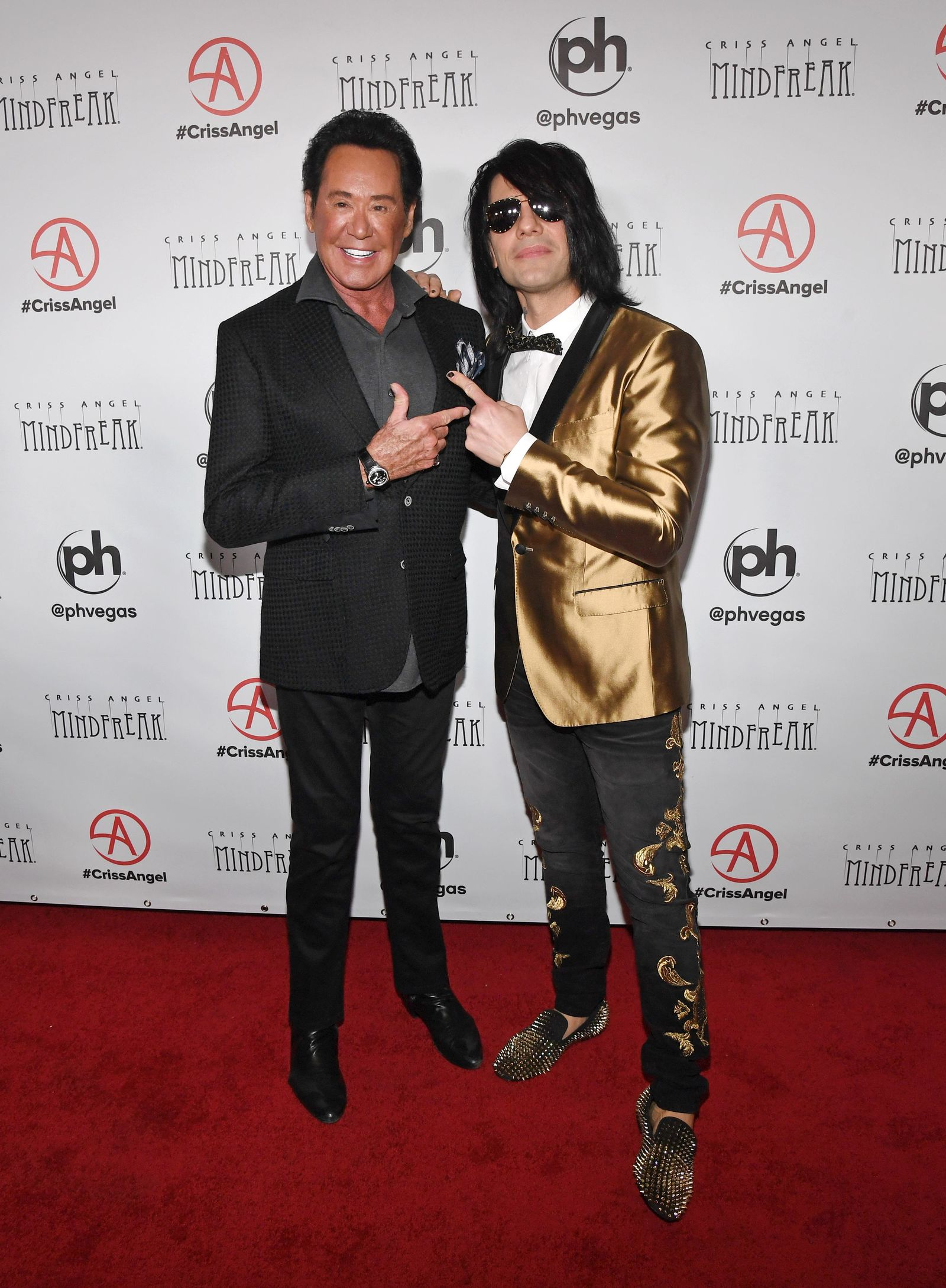 "LAS VEGAS, NEVADA - JANUARY 19:  Entertainer Wayne Newton (L) and illusionist Criss Angel attend the grand opening of ""Criss Angel MINDFREAK"" at Planet Hollywood Resort & Casino on January 19, 2019 in Las Vegas, Nevada.  (Photo by Ethan Miller/Getty Images for Planet Hollywood Resort & Casino)"